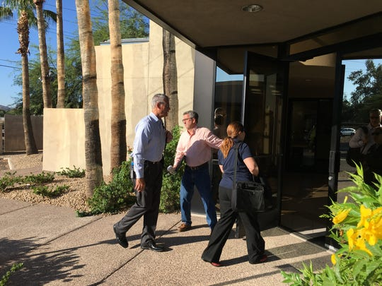 EPCOR Vice President of Operations Troy Day holds the door for colleagues, Greg Barber and Claudia Christo, as they enter the headquarters of Johnson Utilities in Phoenix on  Aug. 31, 2018. The Arizona Corporation Commission ordered EPCOR to take over as interim manager of Johnson, which has faced a variety of issues.