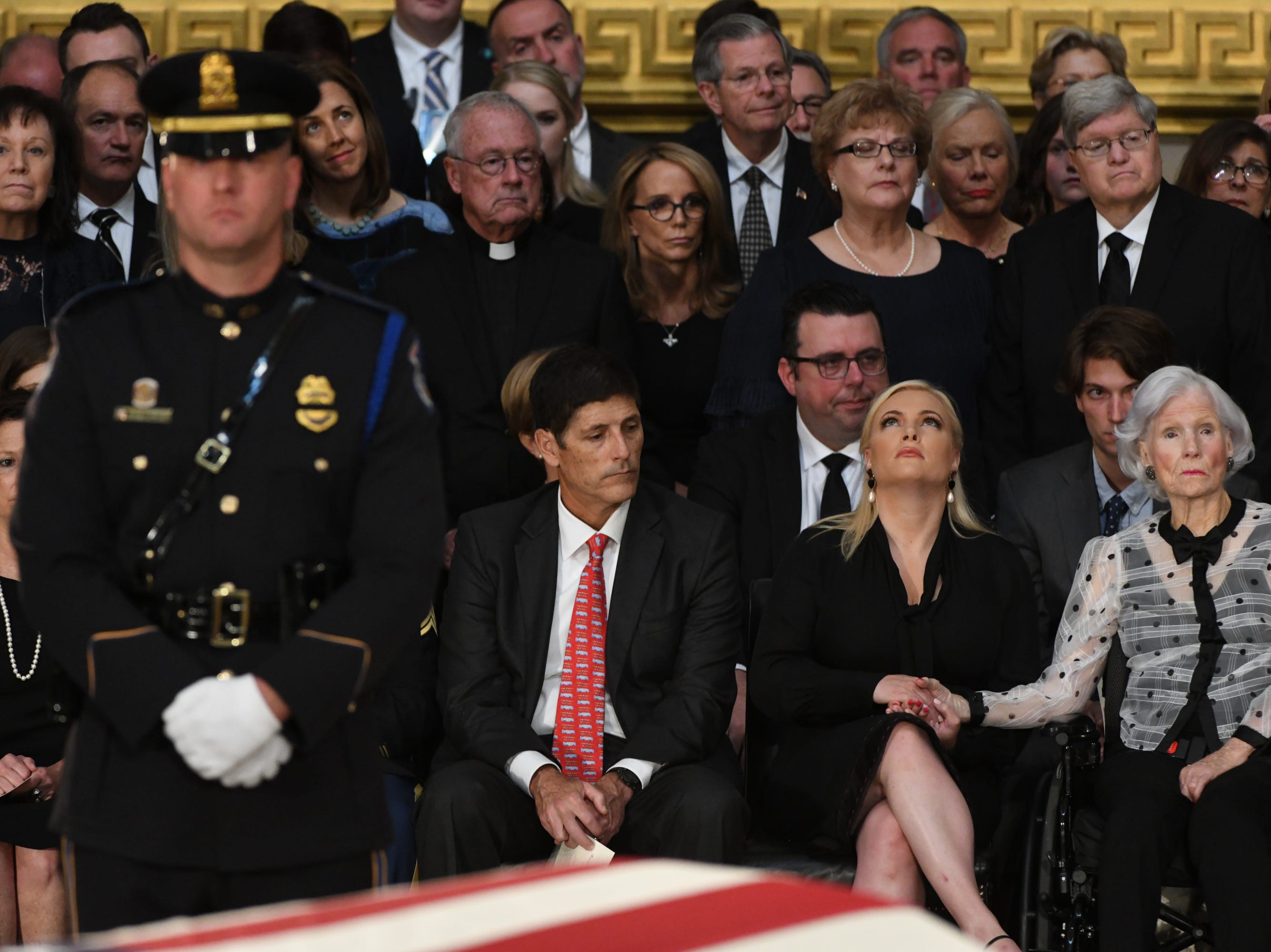 Meghan and Roberta McCain hold hands as the body of Sen. John McCain lies in state at the U.S. Capitol in Washington on Aug. 31, 2018.