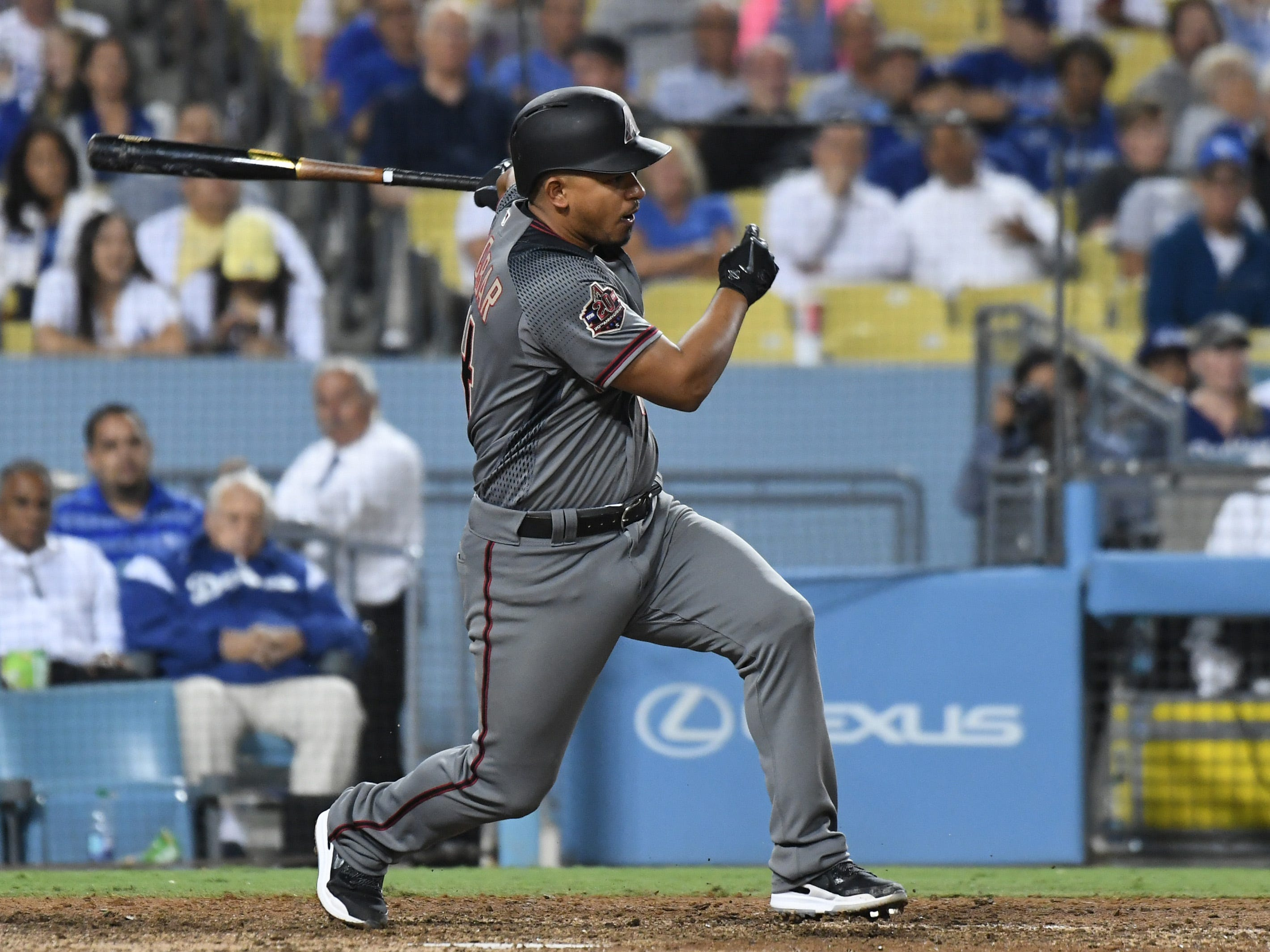 Aug 30, 2018; Los Angeles, CA, USA; Arizona Diamondbacks third baseman Eduardo Escobar (14) hits a single against the Los Angeles Dodgers in the eighth inning at Dodger Stadium. Mandatory Credit: Richard Mackson-USA TODAY Sports