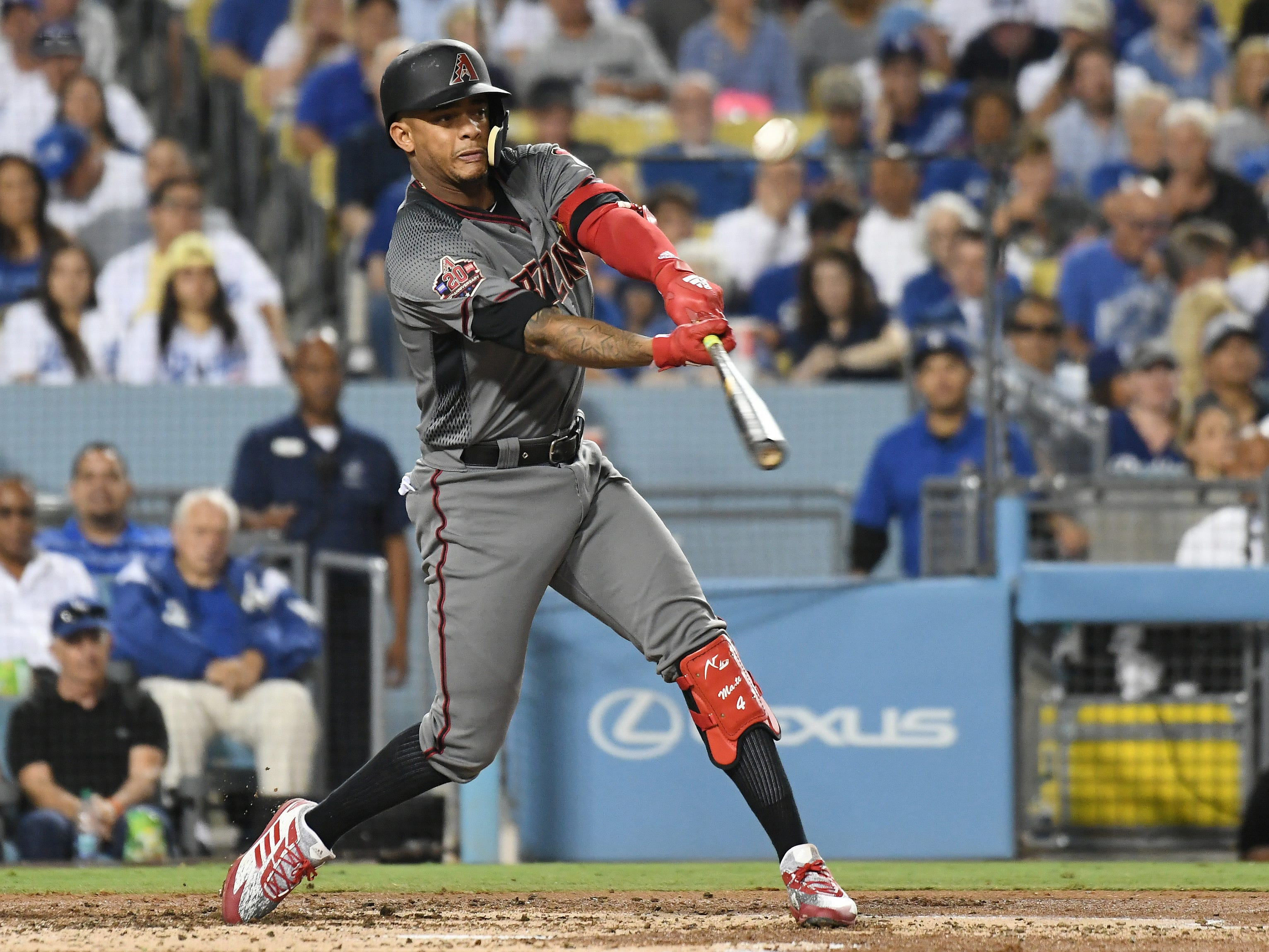 Aug 30, 2018; Los Angeles, CA, USA; Arizona Diamondbacks shortstop Ketel Marte (4) hits a single against the Los Angeles Dodgers in the second inning at Dodger Stadium. Mandatory Credit: Richard Mackson-USA TODAY Sports