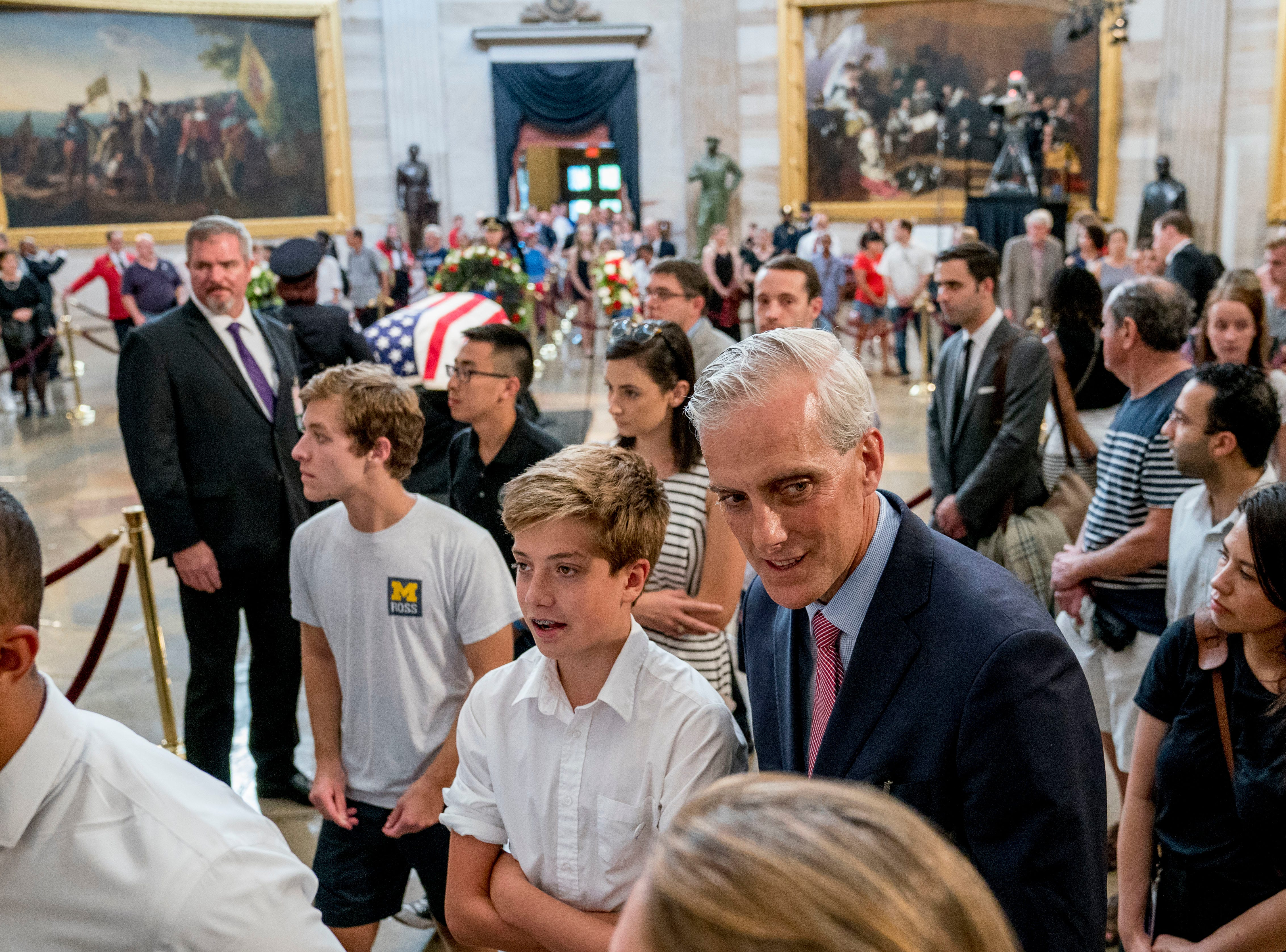 President Barack Obama's White House Chief of Staff Denis McDonough, center right, walks through the Rotunda as Sen. John McCain, R-Ariz., lies in state at the U.S. Capitol, Friday, Aug. 31, 2018, in Washington. (AP Photo/Andrew Harnik)