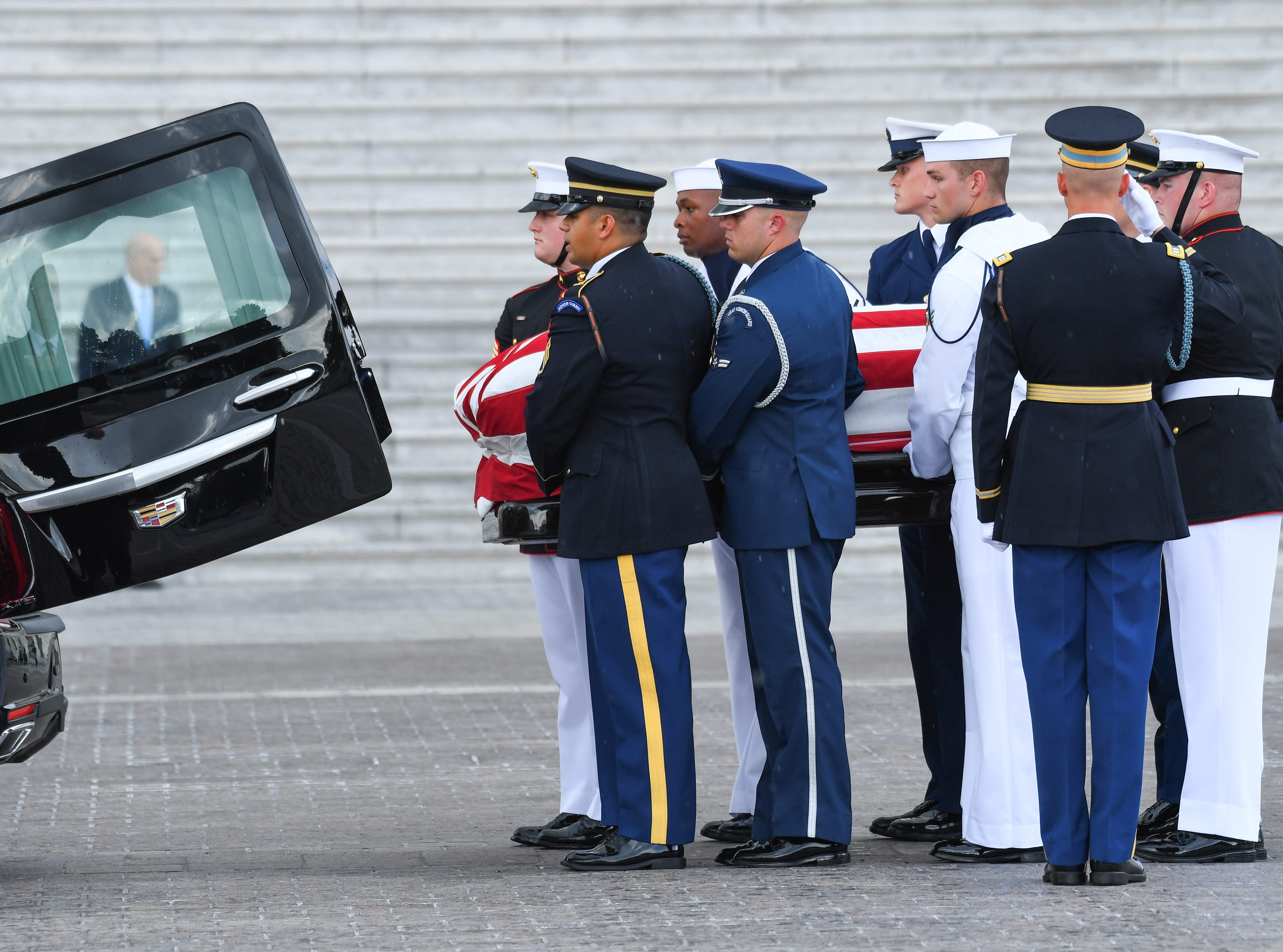The body of John McCain arrives at the U.S. Capitol where he will lie in state in Washington on Aug. 31, 2018.