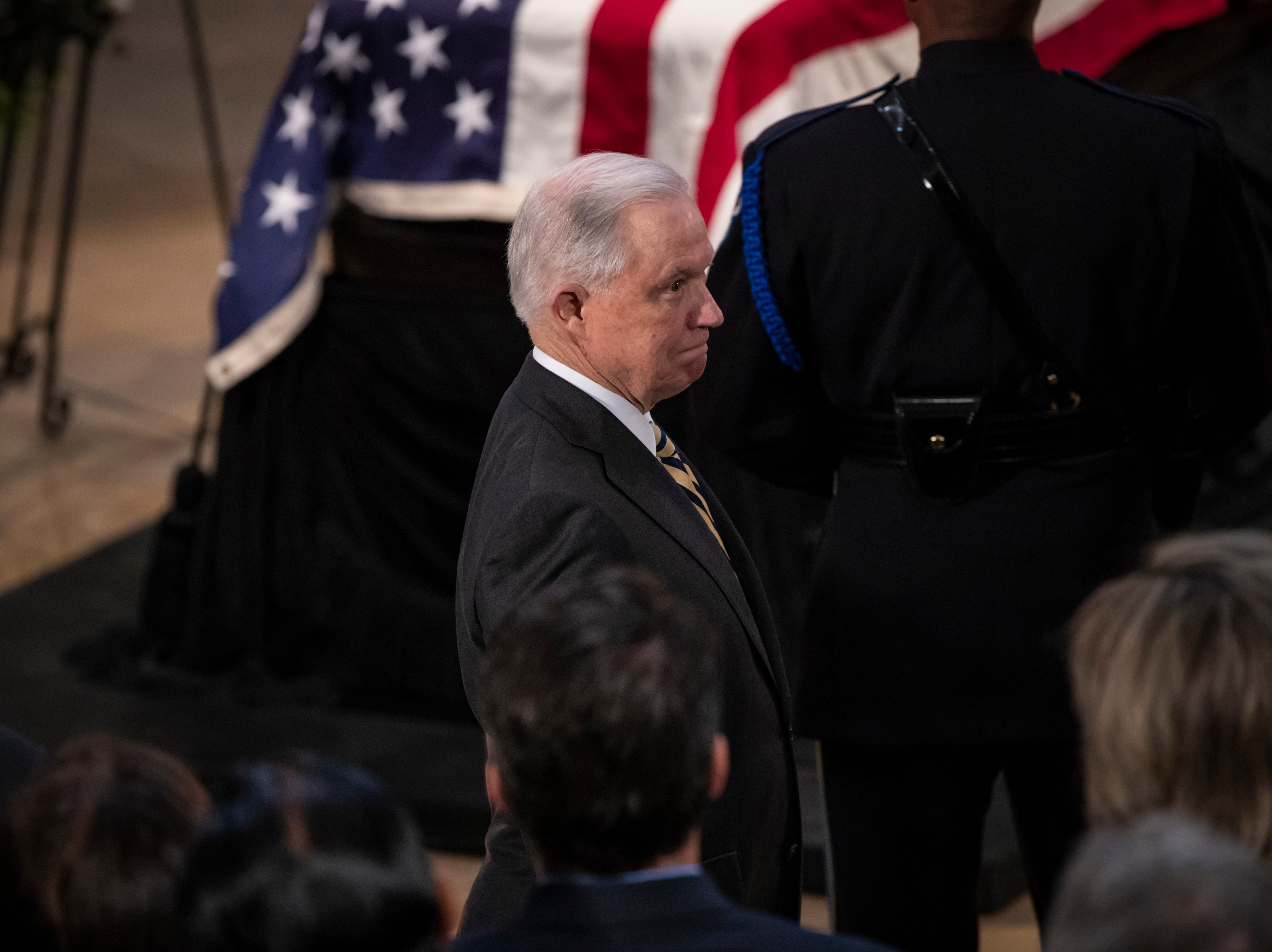 Attorney General Jeff Sessions passes by the flag-draped casket of Sen. John McCain of Arizona, who lived and worked in Congress over four decades, in the U.S. Capitol rotunda, Friday, Aug. 31, 2018, in Washington. McCain was a six-term senator, a former Republican nominee for president, and a Navy pilot who served in Vietnam, where he endured five-and-a-half years as a prisoner of war. He died Aug. 25 from brain cancer at age 81. (AP Photo/J. Scott Applewhite)