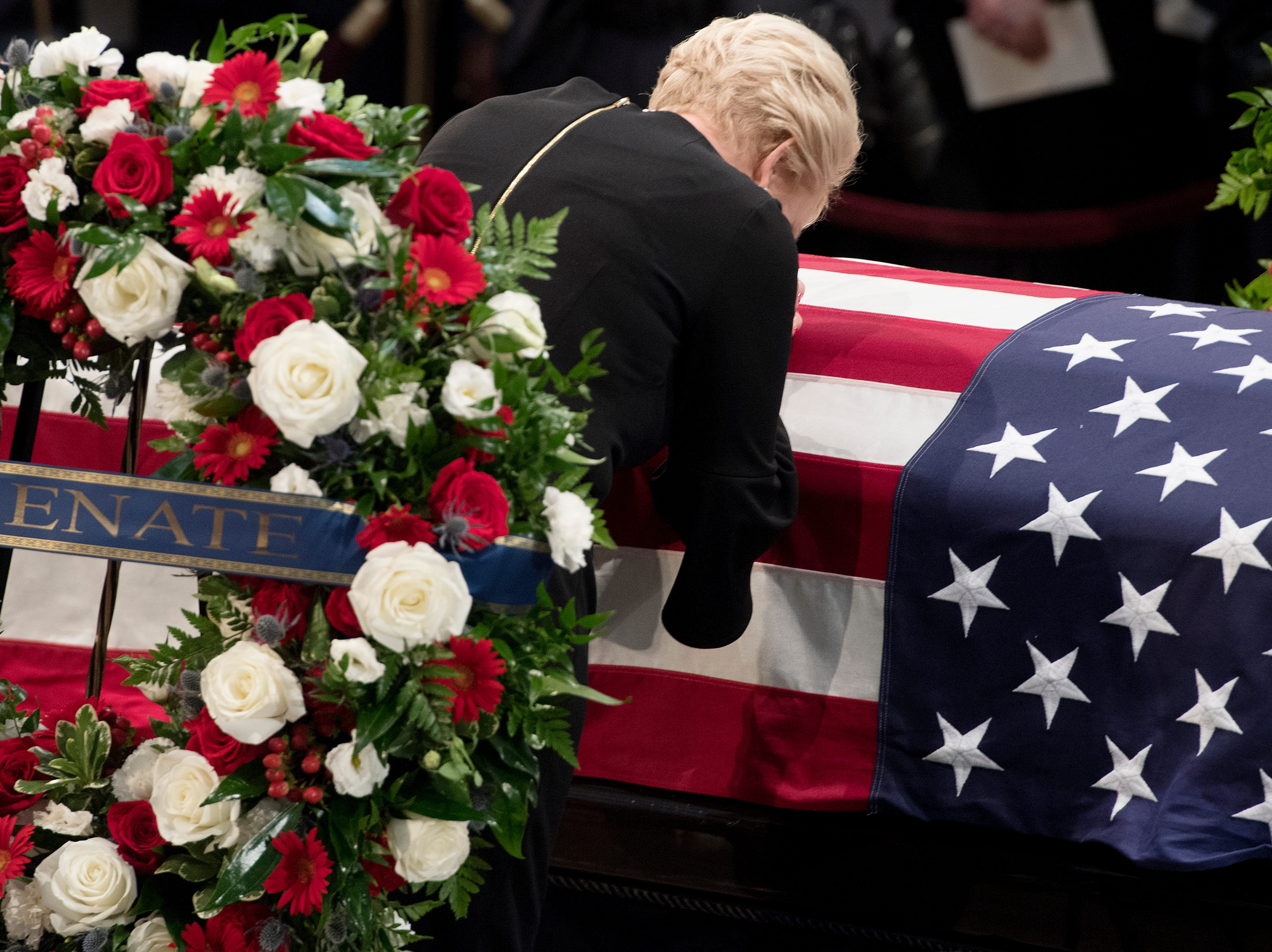 Cindy McCain pays her respects to the flag-draped casket bearing the remains of her husband Sen. John McCain, R-Ariz., in the U.S. Capitol, Friday, Aug. 31, 2018 in Washington. (Jim Watson/Pool photo via AP)