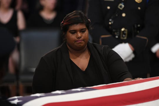 Bridget McCain pays her respects to her father, Sen. John McCain, as he lies in state at the U.S. Capitol in Washington on Aug. 31, 2018.