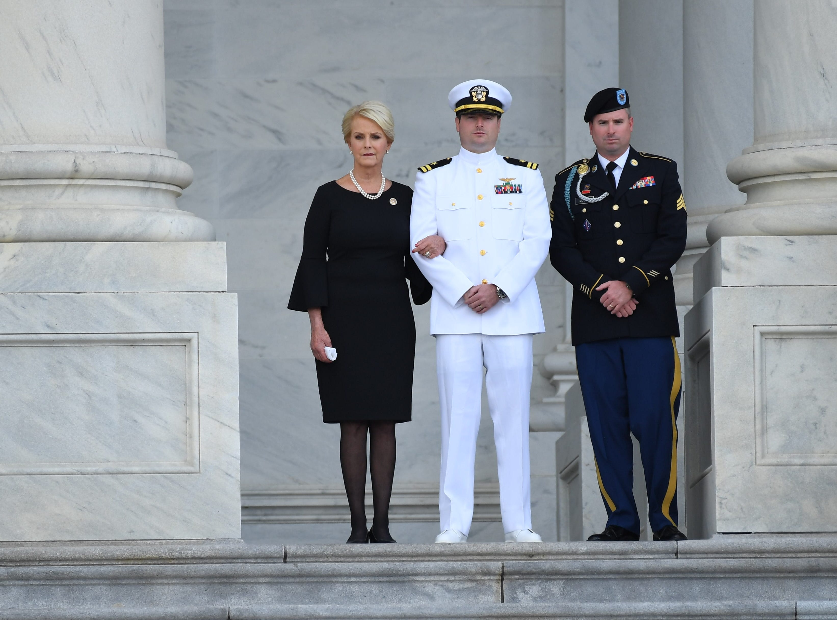 Cindy McCain, wife of Sen. John McCain, watches along with their two sons Jack and Jimmy McCain as his casket arrives at the U.S. Capitol in Washington on Aug. 31, 2018.