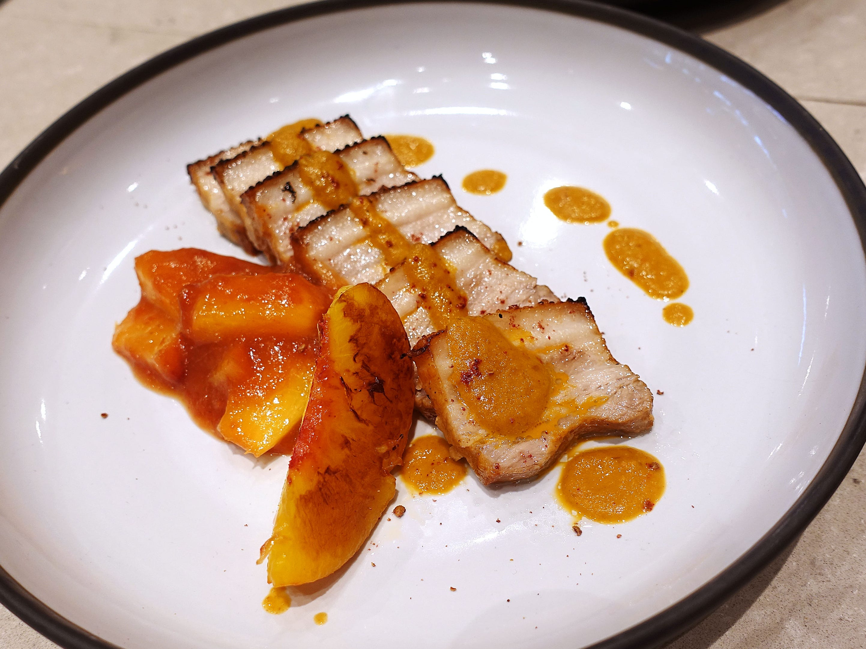 Buttermilk braised pork belly with orange-peach marmalade and sumac hot sauce at Mowry & Cotton in Phoenix.