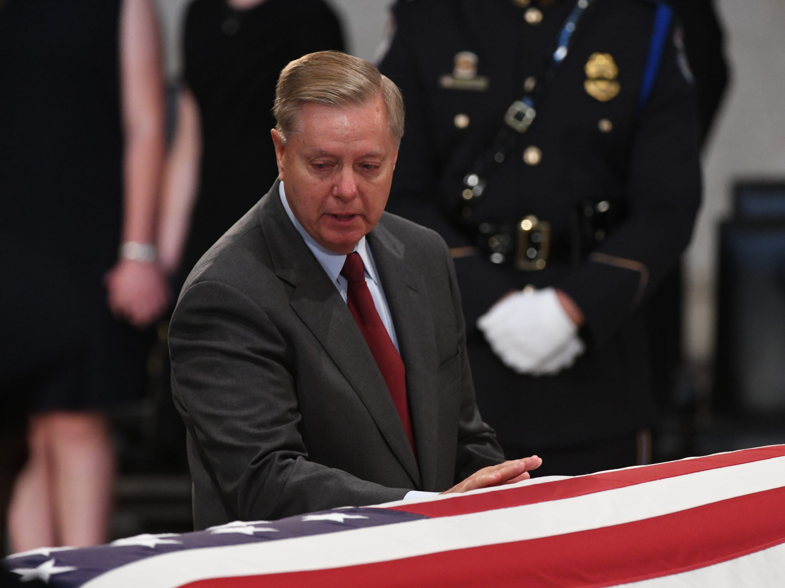 8/31/18 11:35:27 AM -- Washington, DC, U.S.A  -- Lindsey Grahama pays his respects as the body of John McCain lies in state at the U.S. Capitol in Washington on Aug. 31, 2018 in Washington. Sen. McCain died on Aug. 25. --    Photo by Jasper Colt, USA TODAY Staff
