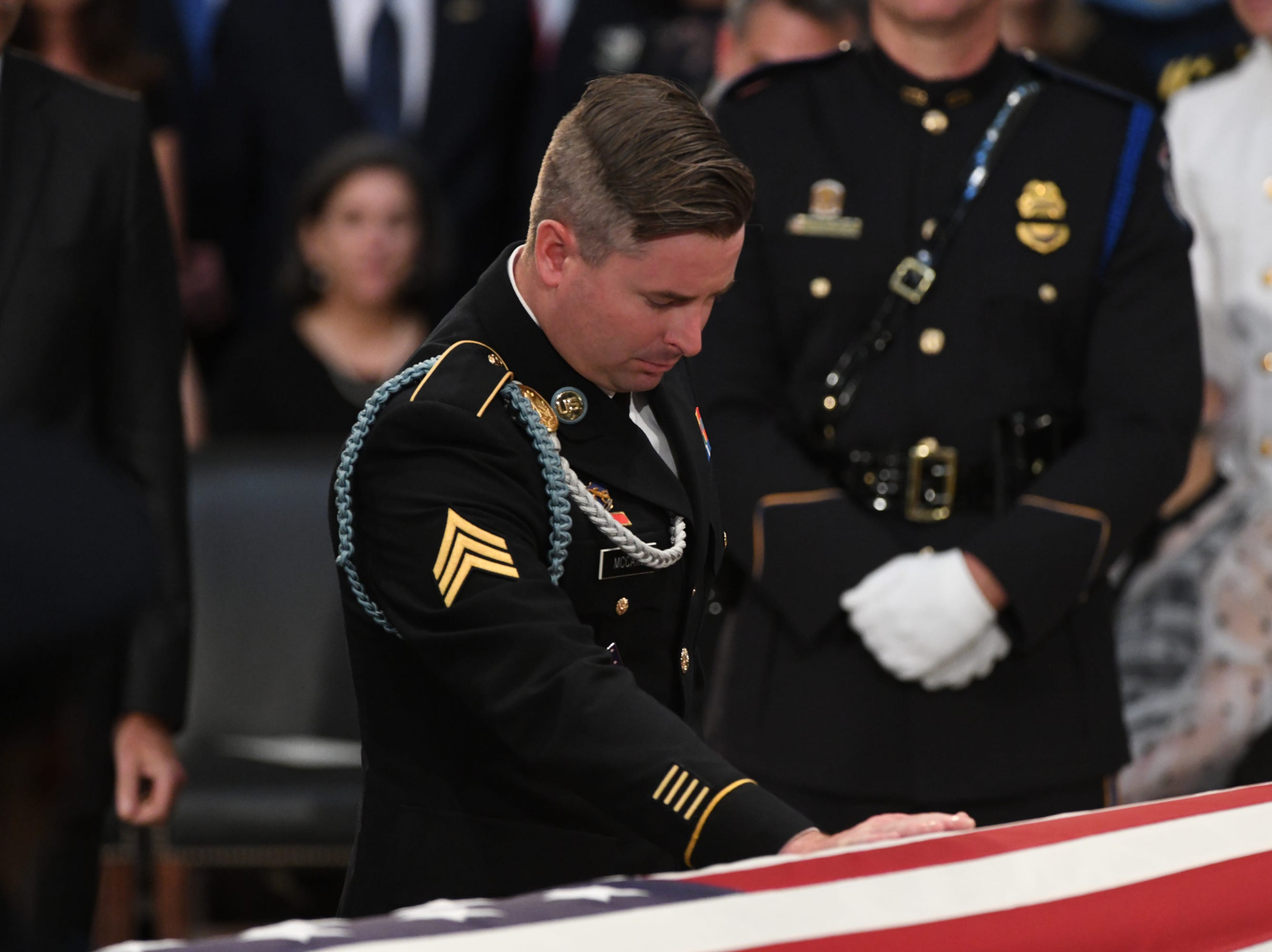 8/31/18 11:25:19 AM -- Washington, DC, U.S.A  -- Jimmy McCain leans on his father's casket as the body of John McCain lies in state at the U.S. Capitol in Washington on Aug. 31, 2018 in Washington. Sen. McCain died on Aug. 25. --    Photo by Jasper Colt, USA TODAY Staff
