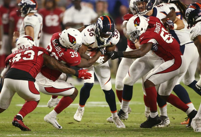 Arizona Cardinals Deatrick Nichols (35) tackles Denver Broncos David Williams (36) during a NFL football game in the first half on Aug. 30, 2018 in Glendale, Ariz.