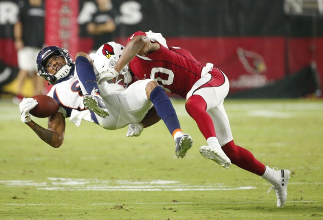 Arizona Cardinals defensive back Rudy Ford (30) tackles Denver Broncos wide receiver Tim Patrick (81) during a NFL game at the University of Phoenix Stadium in Glendale on August 30, 2018.