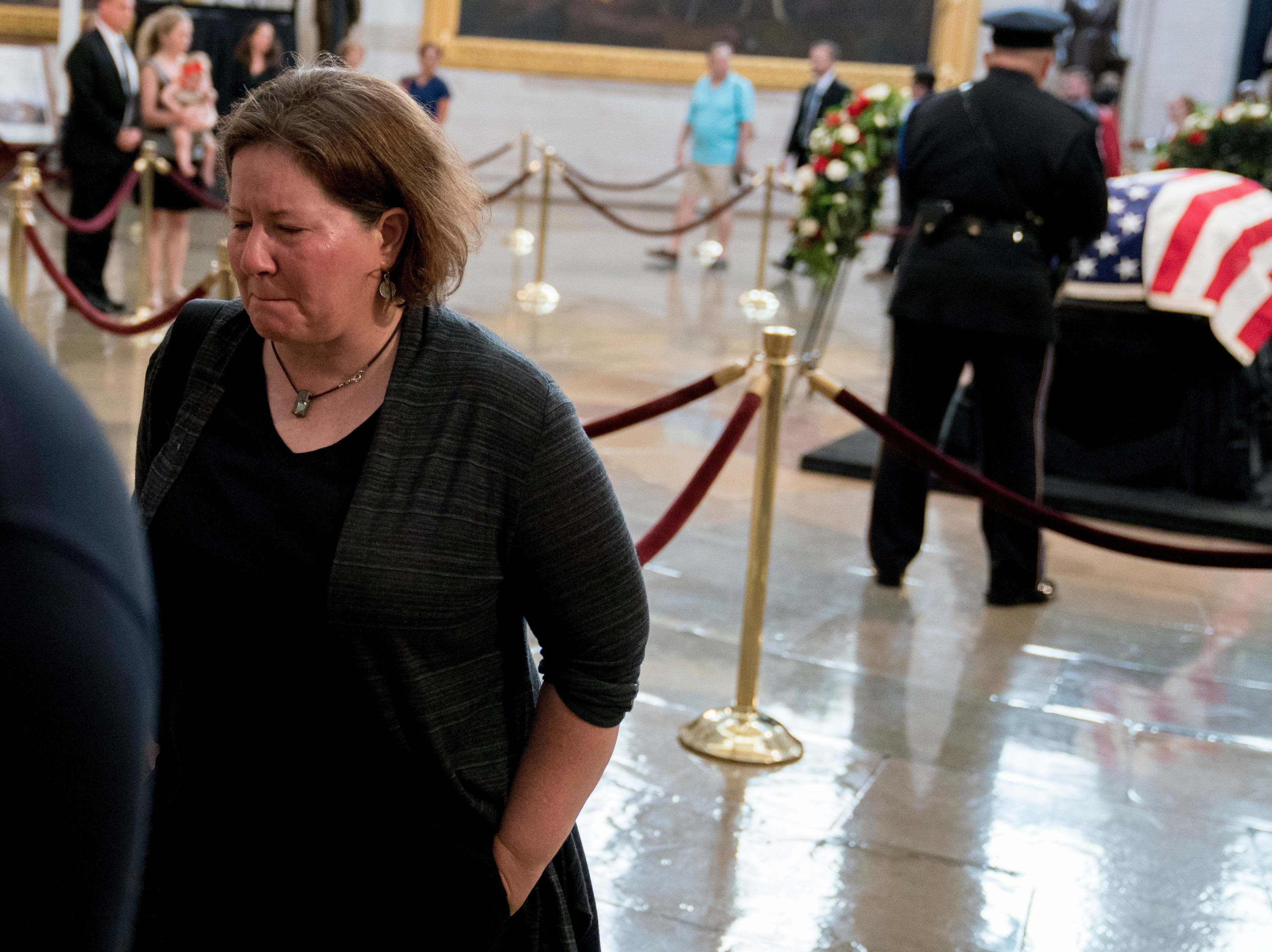 A visitor becomes emotional while paying respects to Sen. John McCain, R-Ariz., as McCain lies in state in the Rotunda of the U.S. Capitol, Friday, Aug. 31, 2018, in Washington. (AP Photo/Andrew Harnik)