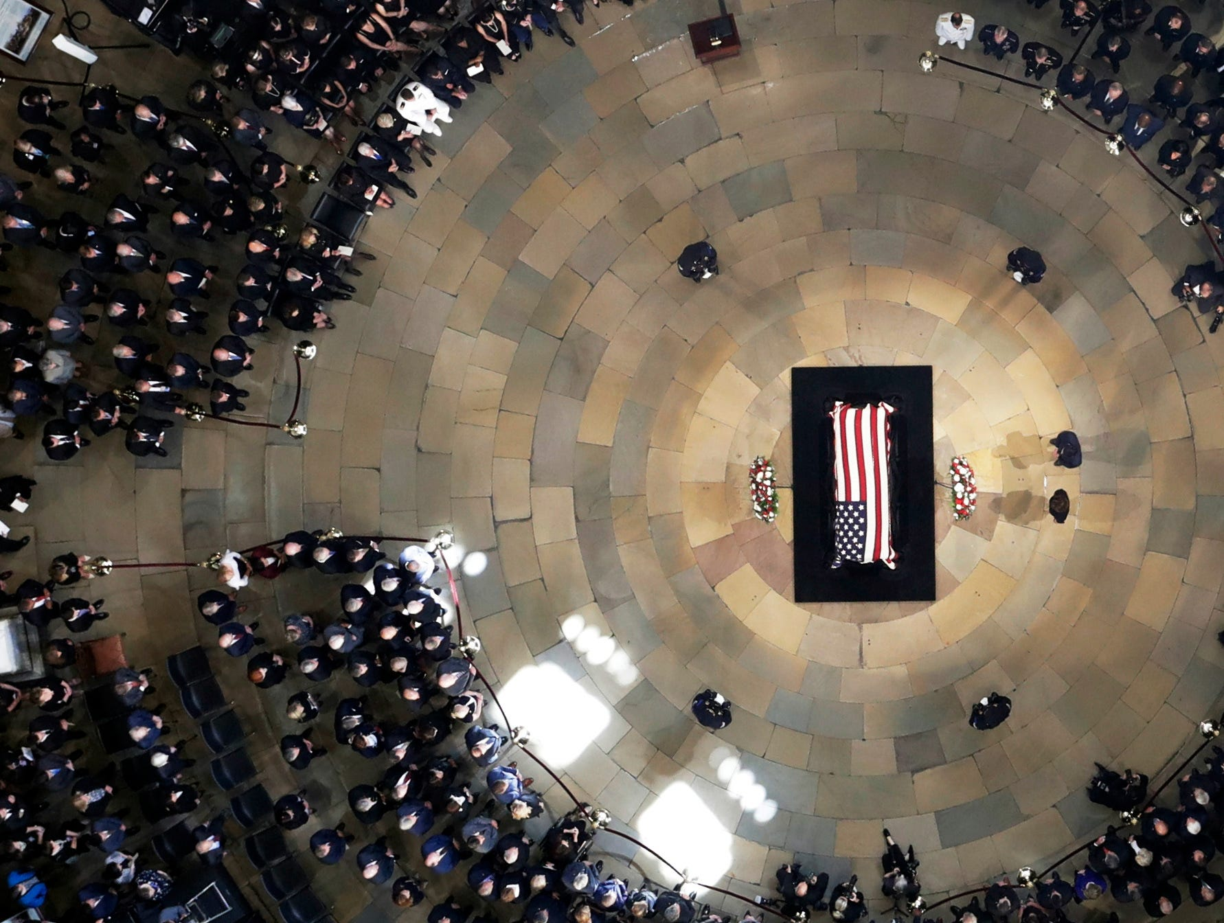 House Speaker Paul Ryan and Minority Leader Nancy Pelosi stand near the casket as Sen. John McCain, R-Ariz., lies in state in the U.S. Capitol rotunda Aug. 31, 2018, in Washington.