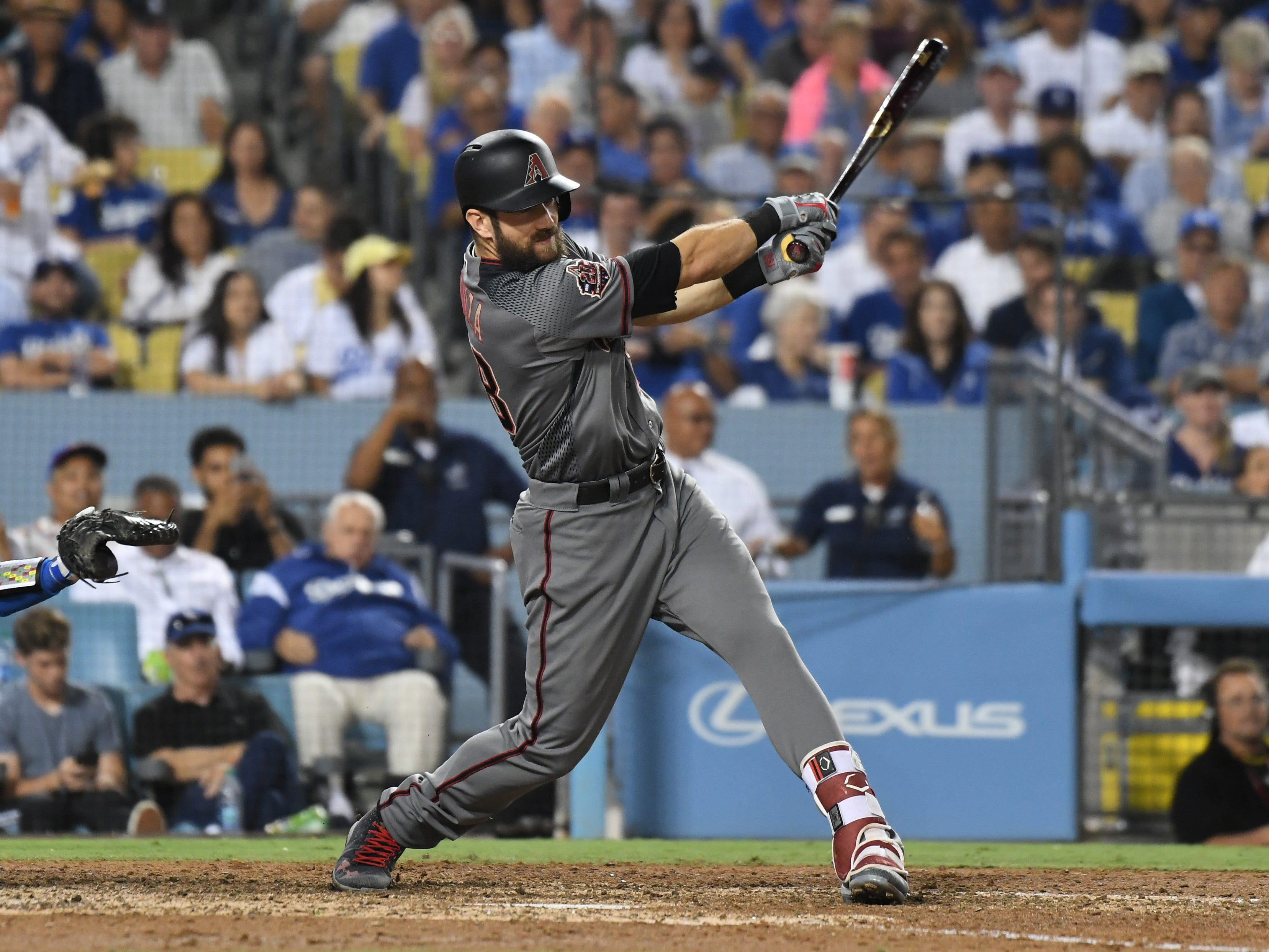 Aug 30, 2018; Los Angeles, CA, USA; Arizona Diamondbacks right fielder Steven Souza Jr. (28) hits a double against the Los Angeles Dodgers in the seventh inning at Dodger Stadium. Mandatory Credit: Richard Mackson-USA TODAY Sports