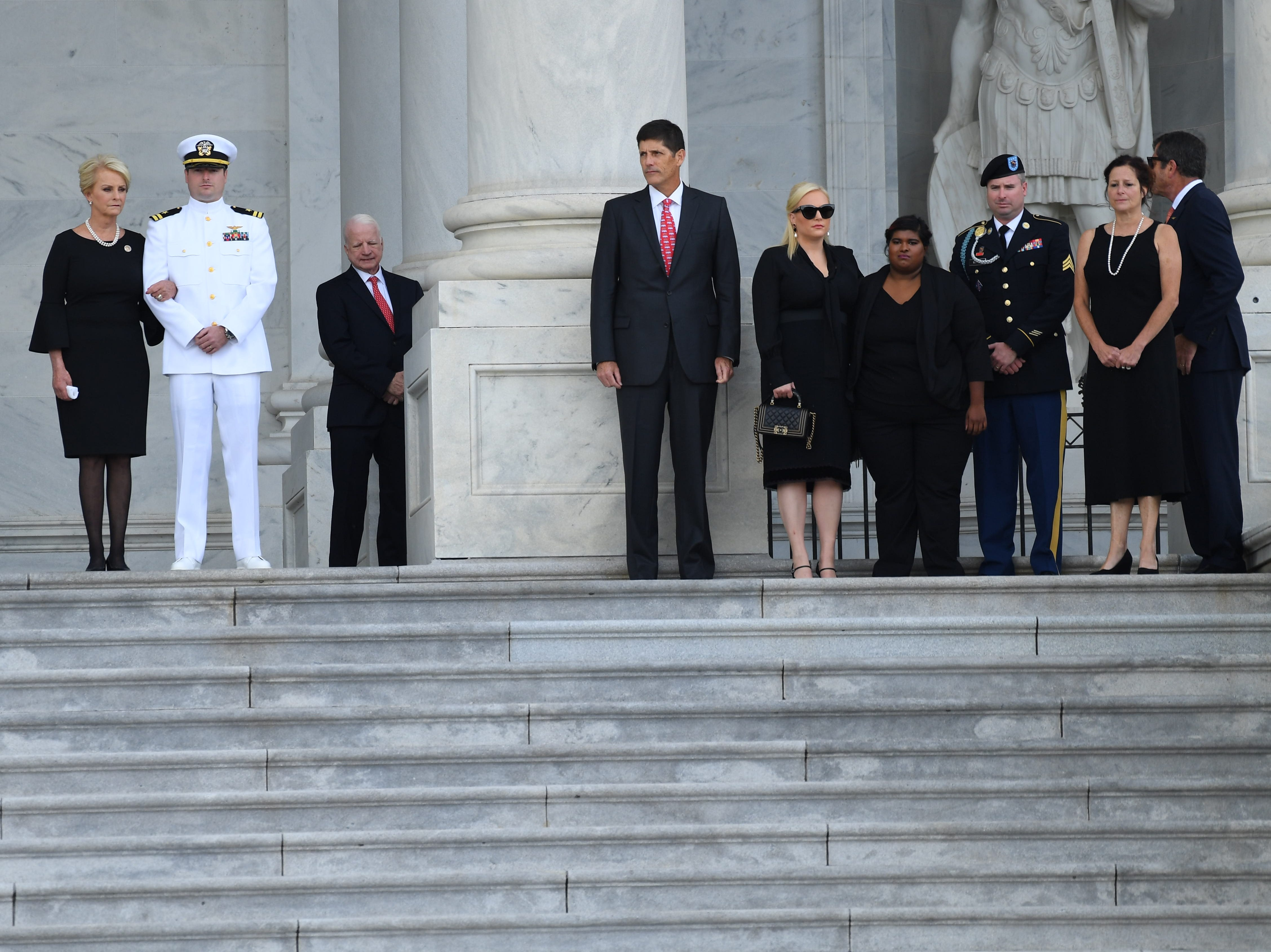 The family of Sen. John McCain waits for the senator's body to arrive at the U.S. Capitol on Aug. 31, 2018 in Washington.