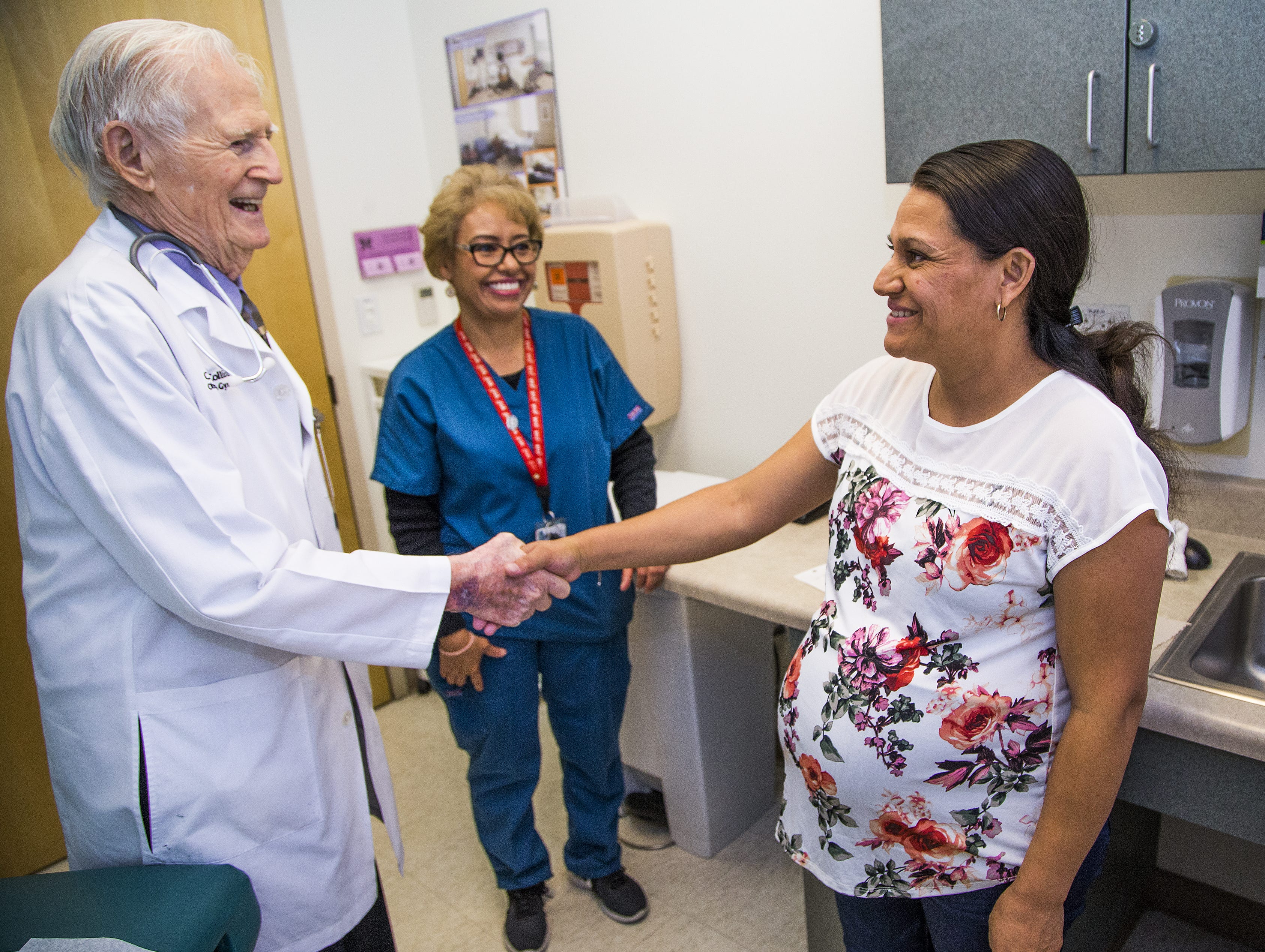 Dr. C. Dale Collins, 98, is finally retiring. Flanked by medical assistant Isabel Gonzalez, he says goodbye to patient Maria Bravo on Aug. 24, 2018.