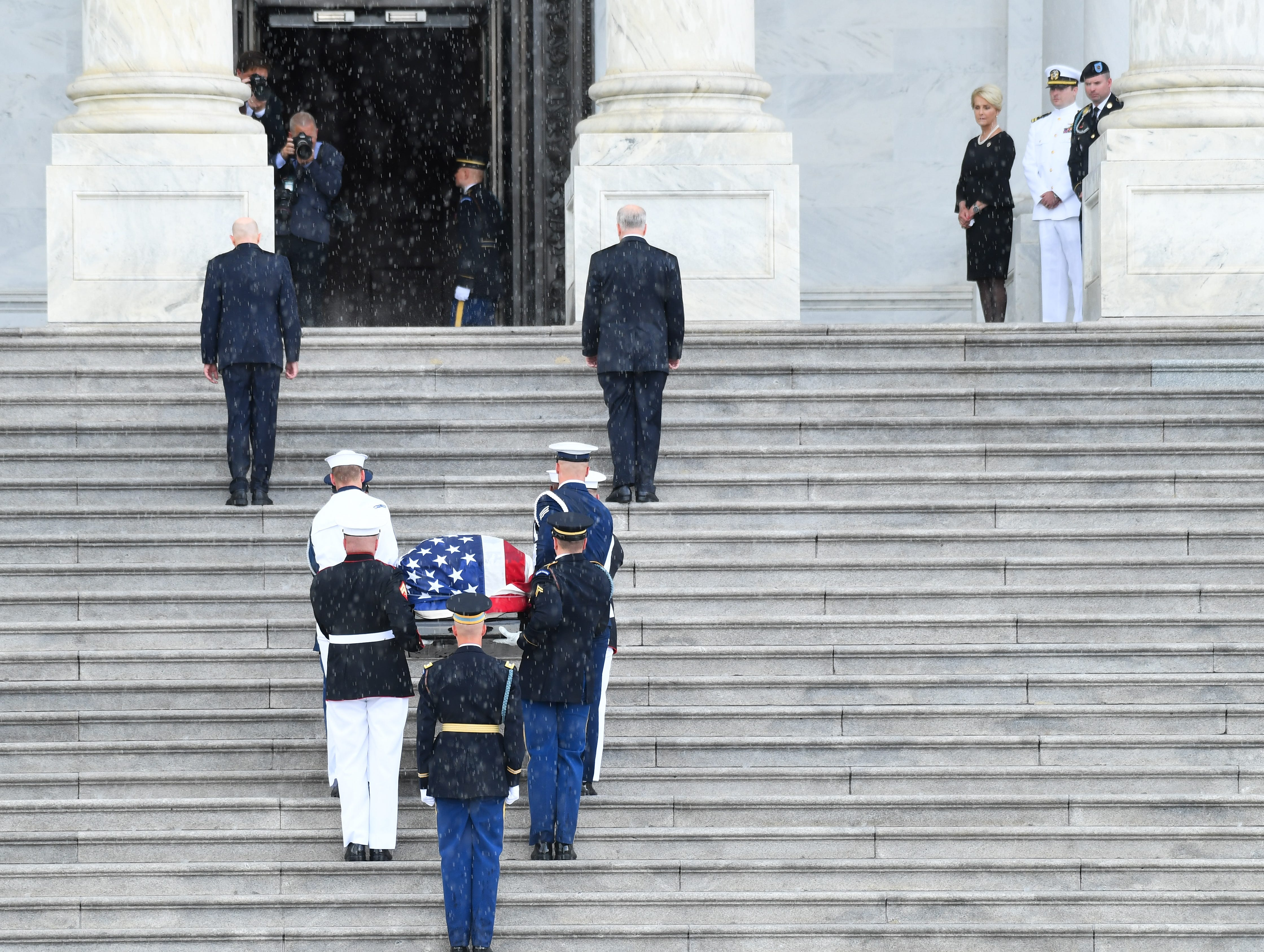 The casket of Sen. John McCain arrives at the U.S. Capitol while his wife, Cindy McCain, along with their two sons Jack and Jimmy McCain, look on at the U.S. Capital in Washington on Aug. 31, 2018.