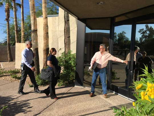 EPCOR Vice President of Operations Troy Day holds the door for colleagues Greg Barber and Claudia Christo as they enter the headquarters of Johnson Utilities in Phoenix on Aug. 31, 2018. The Arizona Corporation Commission ordered EPCOR to take over as interim manager of Johnson, which has faced a variety of issues.