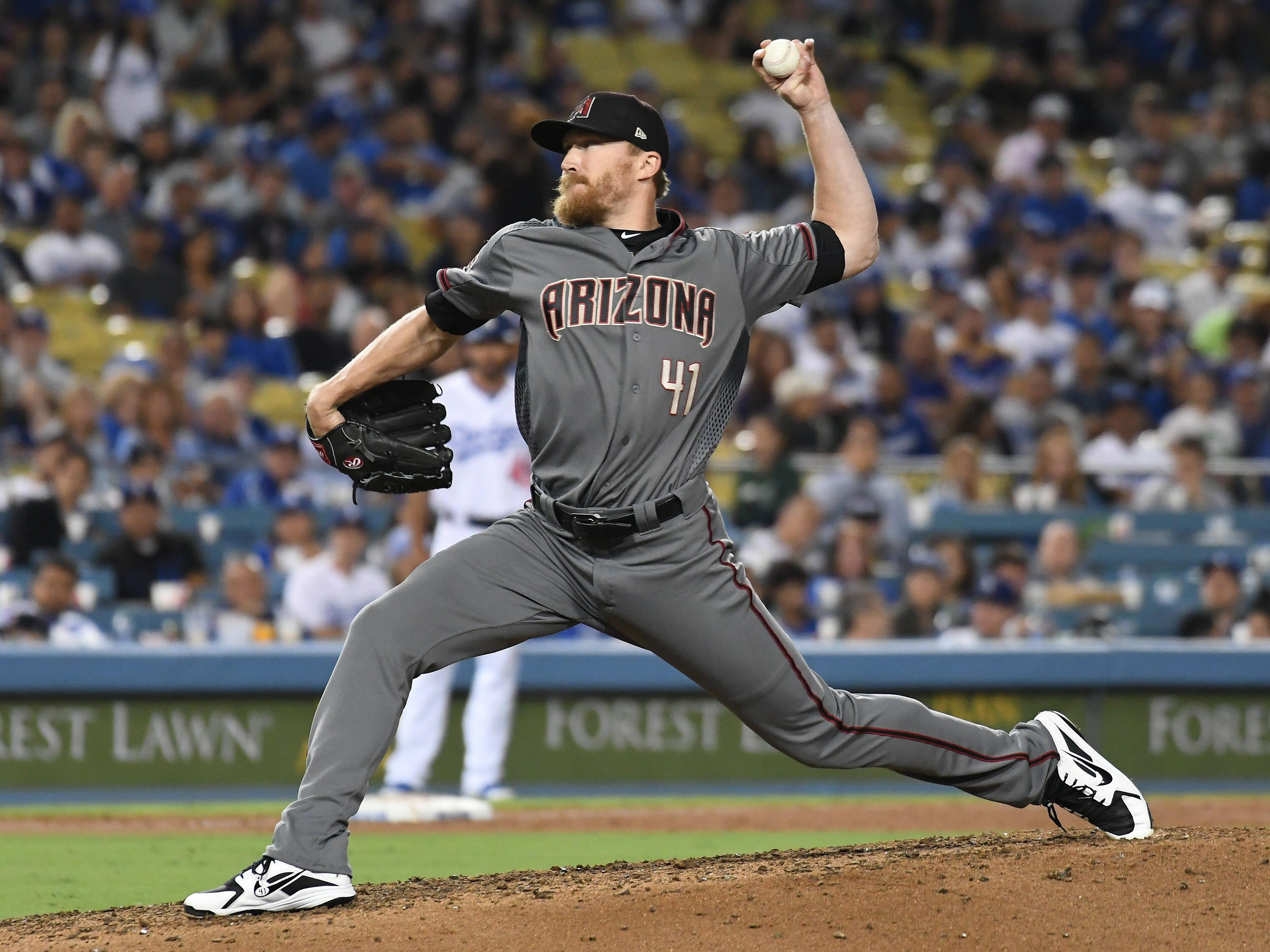 Aug 30, 2018; Los Angeles, CA, USA; Arizona Diamondbacks relief pitcher Jake Diekman (41) pitches against the Los Angeles Dodgers in the seventh inning at Dodger Stadium. Mandatory Credit: Richard Mackson-USA TODAY Sports