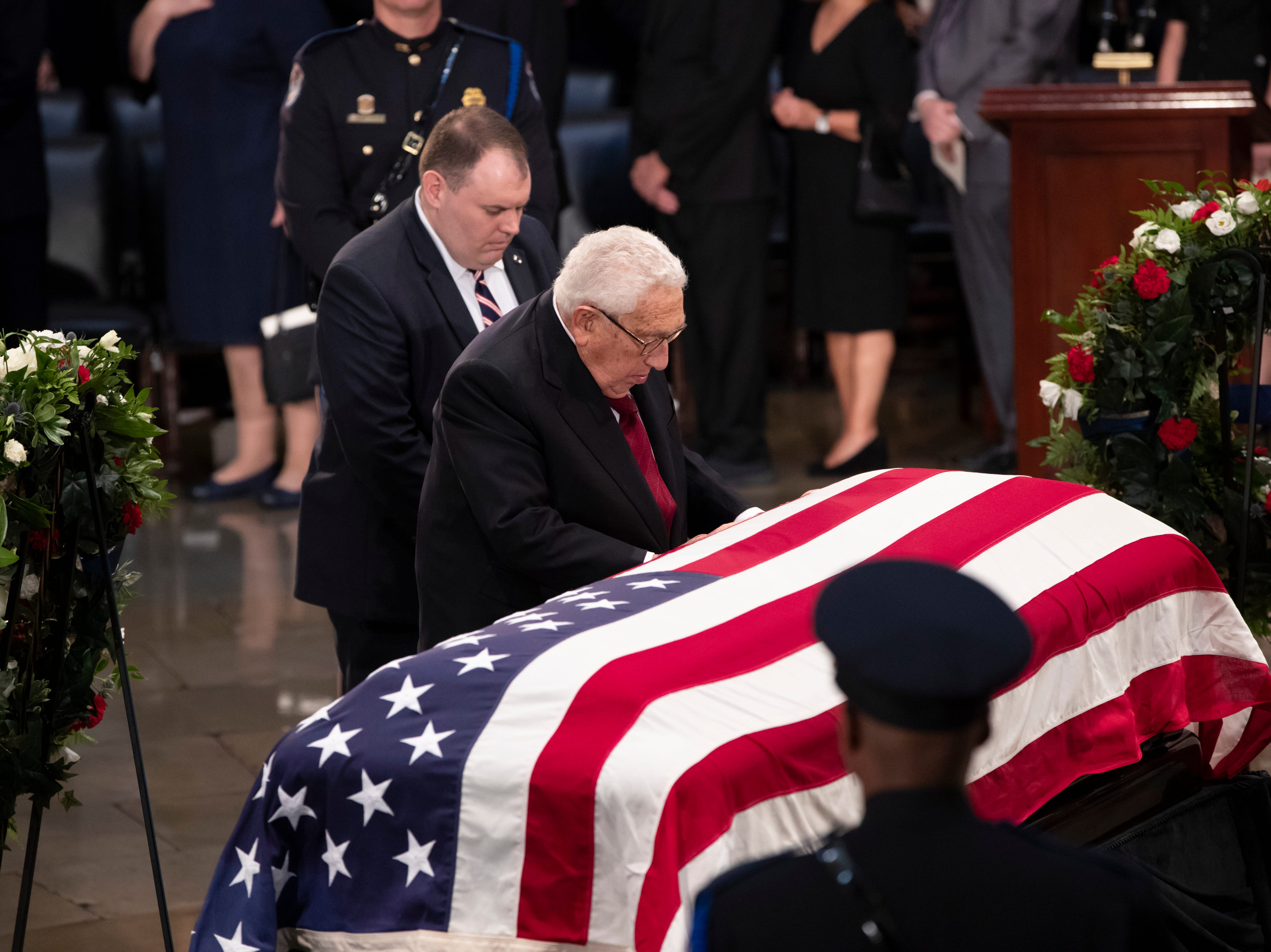 Former Secretary of State Henry Kissinger pays his respects at the flag-draped casket of Sen. John McCain of Arizona, who lived and worked in Congress over four decades, in the U.S. Capitol rotunda, Friday, Aug. 31, 2018, in Washington. McCain was a six-term senator, a former Republican nominee for president, and a Navy pilot who served in Vietnam, where he endured five-and-a-half years as a prisoner of war. He died Aug. 25 from brain cancer at age 81. (AP Photo/J. Scott Applewhite)