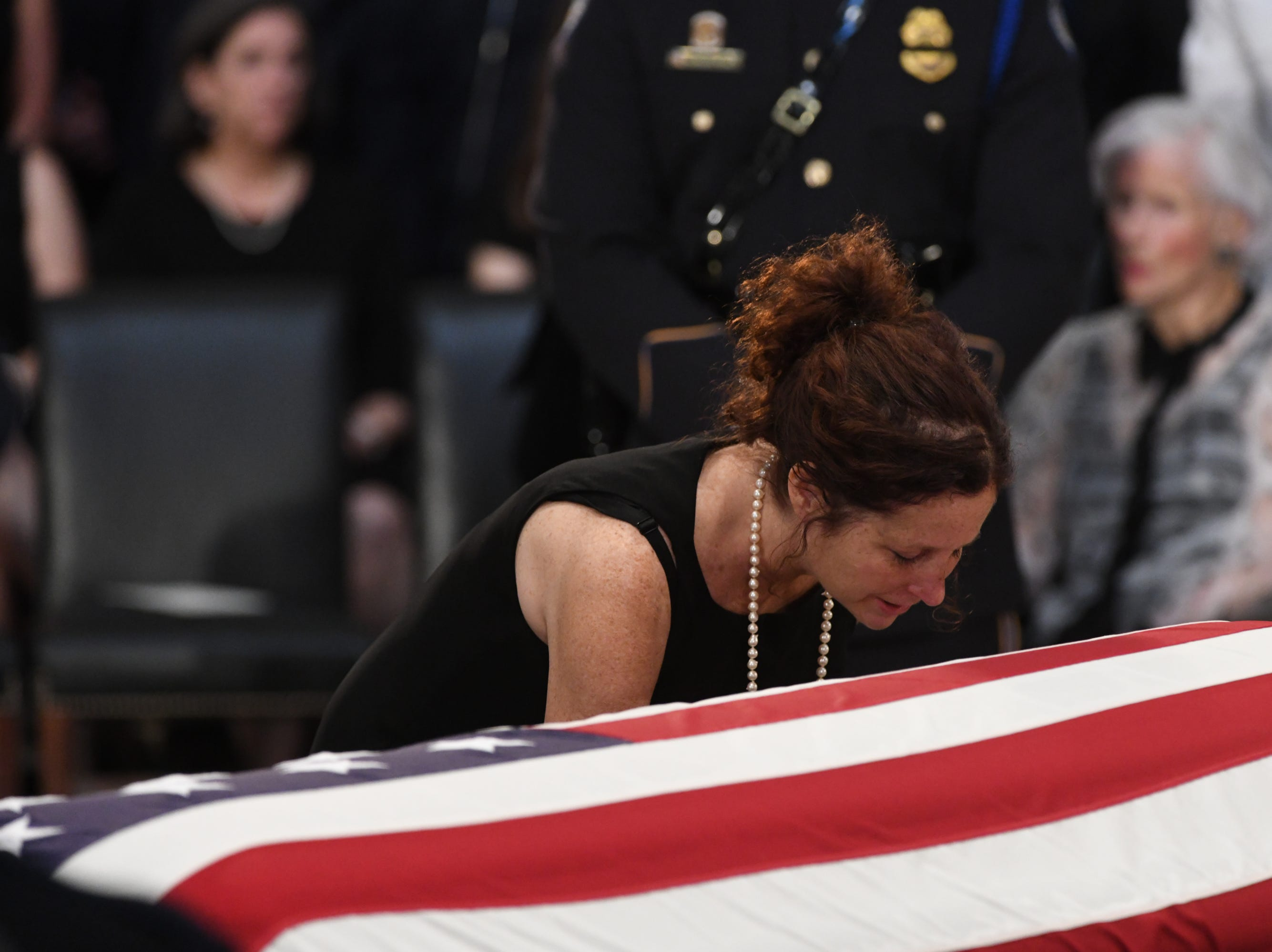 8/31/18 11:25:12 AM -- Washington, DC, U.S.A  -- Sidney McCain whisper to her father's casket as the body of John McCain lies in state at the U.S. Capitol in Washington on Aug. 31, 2018 in Washington. Sen. McCain died on Aug. 25. --    Photo by Jasper Colt, USA TODAY Staff