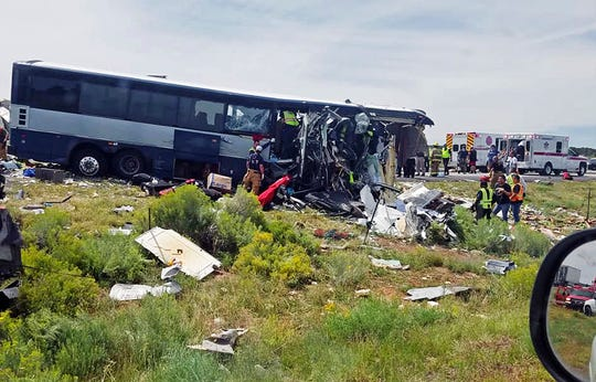 This photo provided by Chris Jones shows first responders working the scene of a collision between a Greyhound passenger bus and a semitruck on Interstate 40 near the town of Thoreau, New Mexico, Aug. 30, 2018.