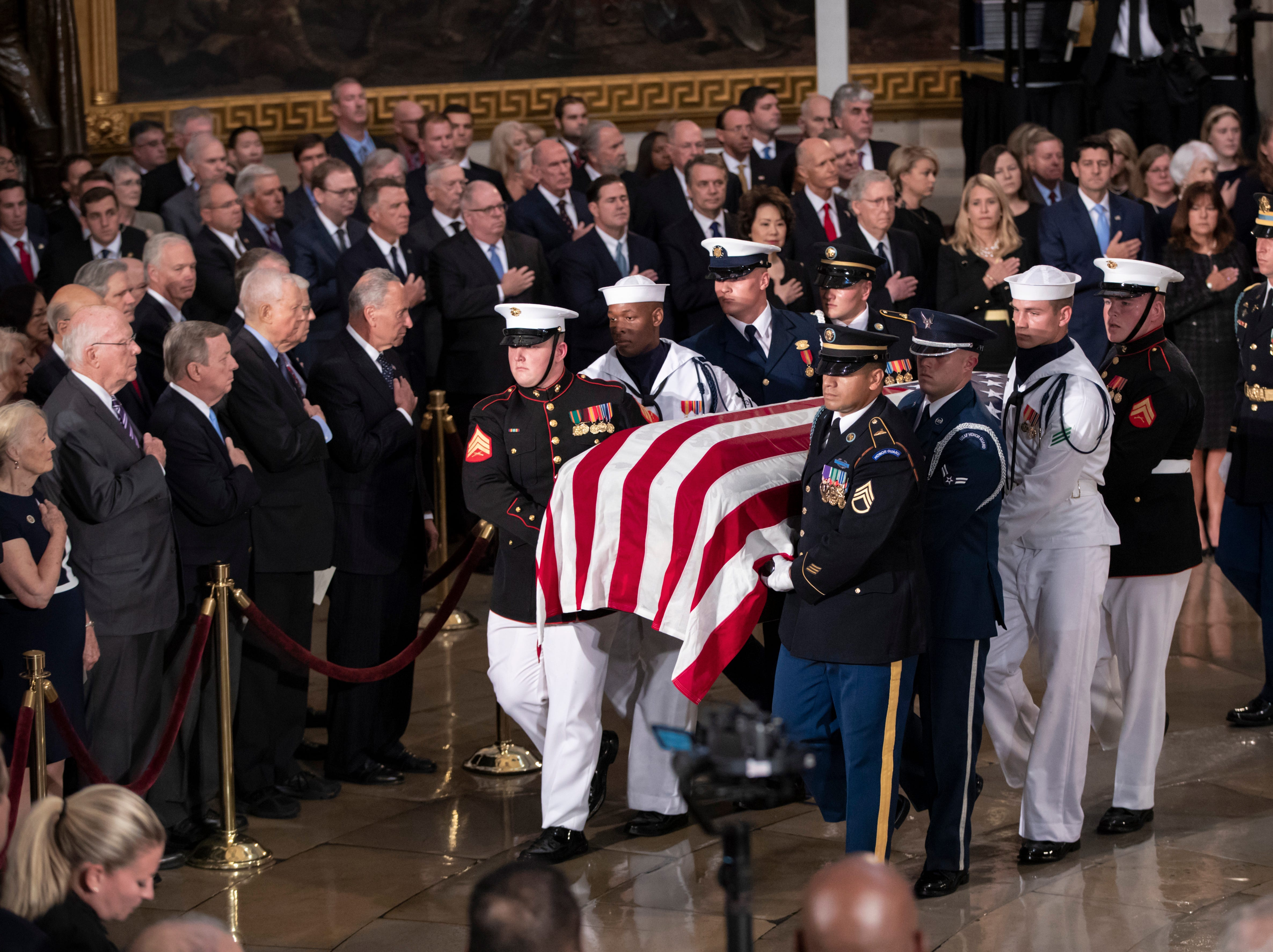 The flag-draped casket of Sen. John McCain, R-Ariz., is carried into the U.S. Capitol rotunda Aug. 31, 2018, in Washington.