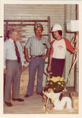Former Mayor Driggs (on the left) with construction workers, 1977.