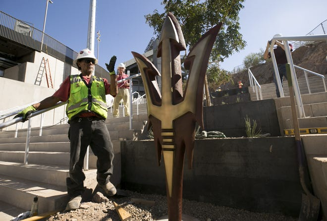 A new bronze pitchfork statue is installed in the southeast corner of Sun Devil Stadium on Aug. 31.