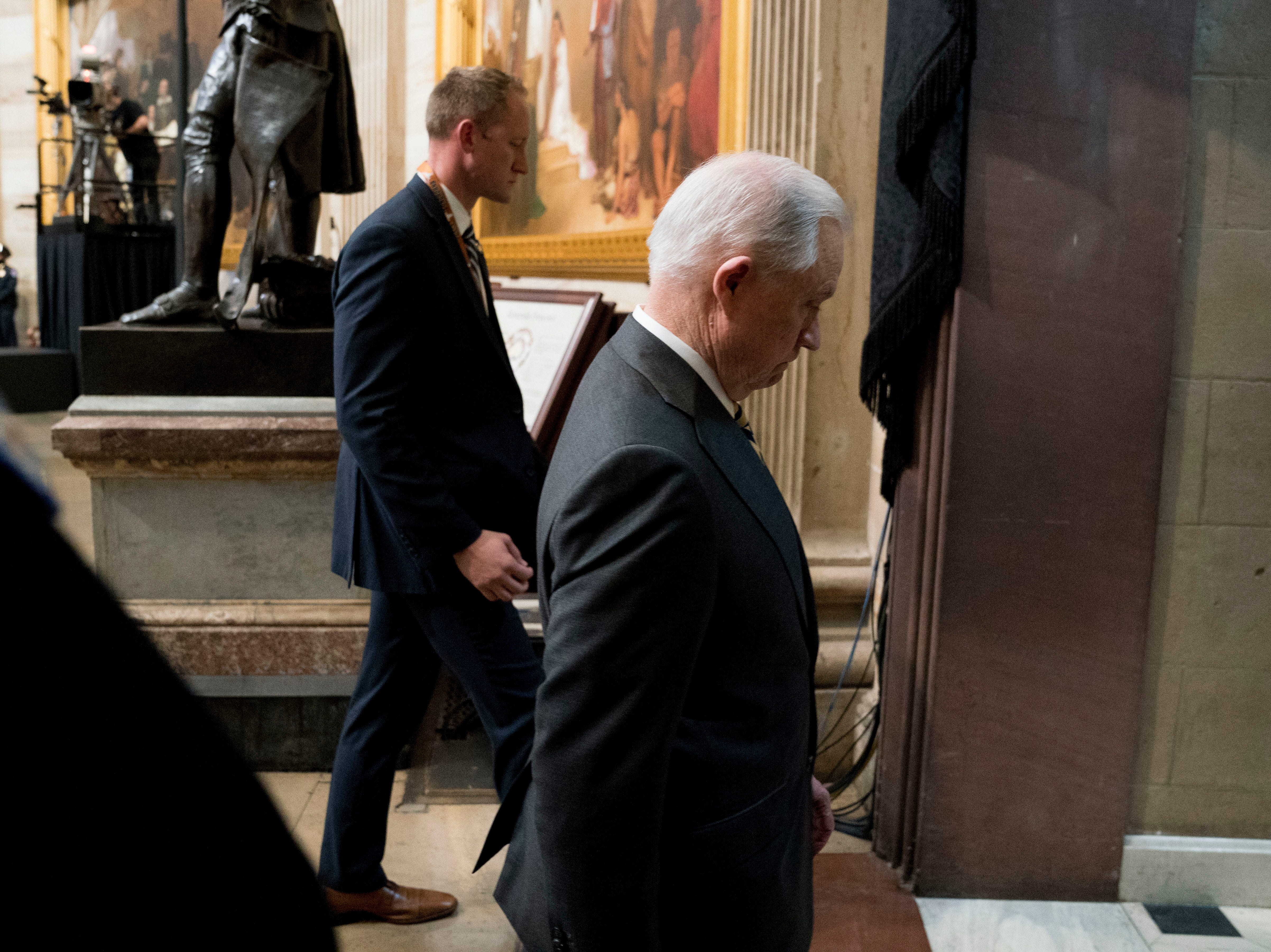 Attorney General Jeff Sessions walks out of the Rotunda where Sen. John McCain, R-Ariz., lies in state in the U.S. Capitol, Friday, Aug. 31, 2018, in Washington. (AP Photo/Andrew Harnik)