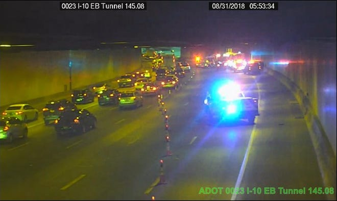 A crash inside the tunnel on eastbound Interstate 10 in Phoenix has closed the right three lanes and created long delays.