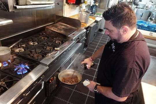 Gio Osso adds marsala to his cuore di manzo ragu at Virtu Honest Craft in Scottsdale.