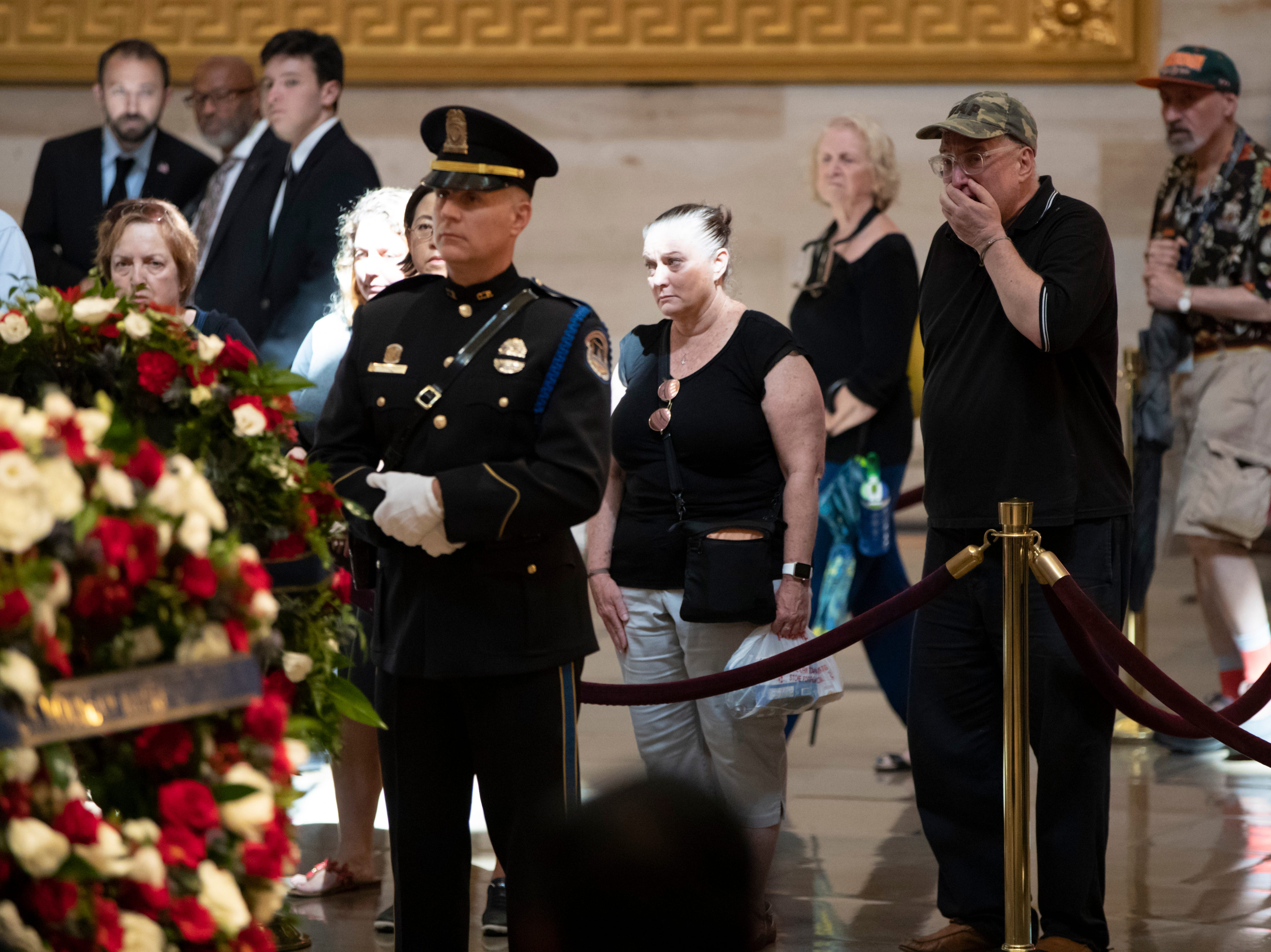Members of the public walk past the flag-draped casket bearing the remains of John McCain of Arizona, who lived and worked in Congress over four decades, in the U.S. Capitol rotunda in Washington, Friday, Aug. 31, 2018. McCain was a six-term senator from Arizona, a former Republican nominee for president, and a Navy pilot who served in Vietnam where he endured five-and-a-half years as a prisoner of war. He died Aug. 25 from brain cancer at age 81. (AP Photo/J. Scott Applewhite)