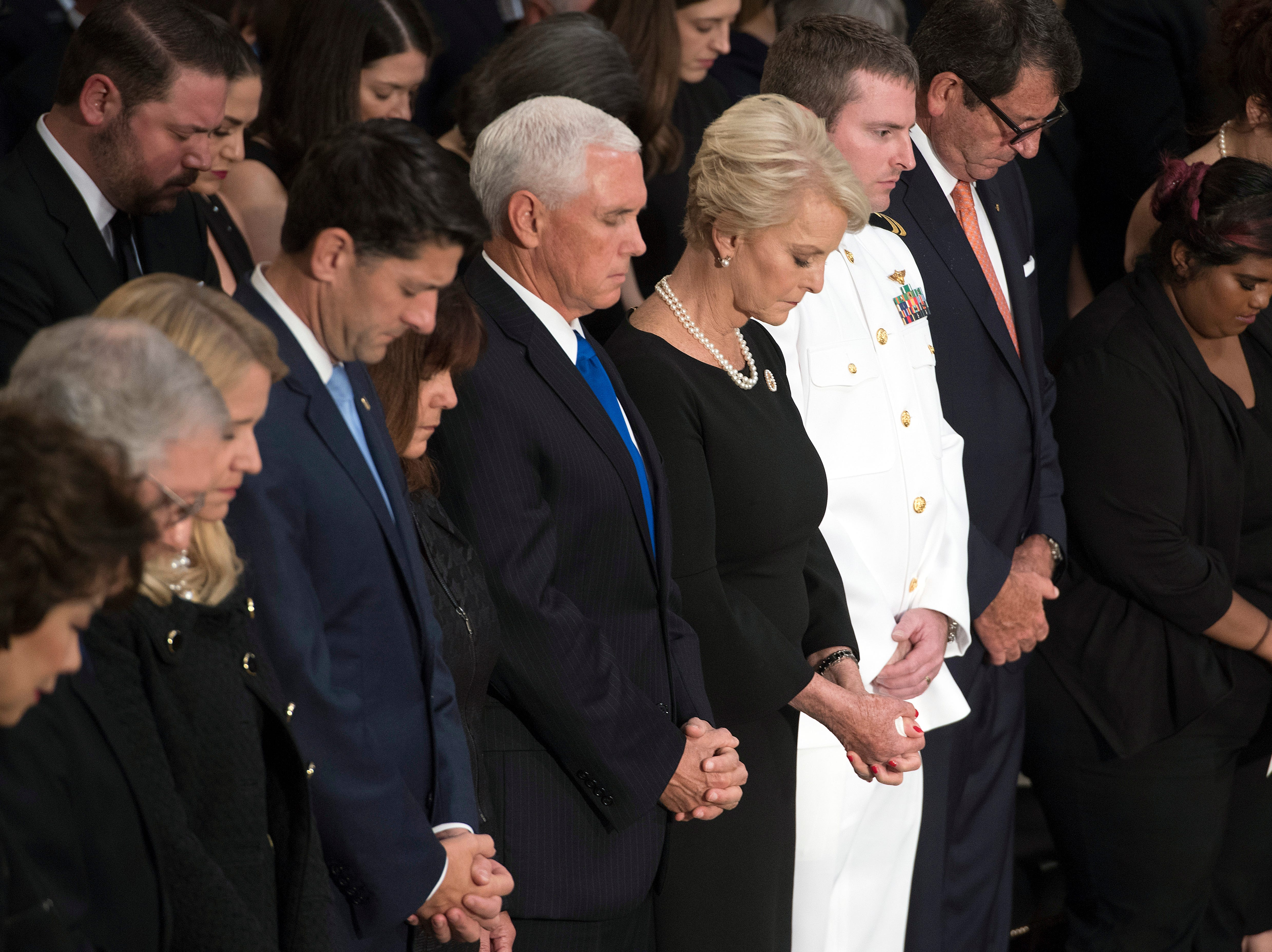 Cindy McCain, center, prays with Vice President Mike Pence and others during a farewell ceremony and public visitation for Sen. John McCain, R-Ariz., in Washington, Friday, Aug. 31, 2018. (Jim Watson/Pool photo via AP)