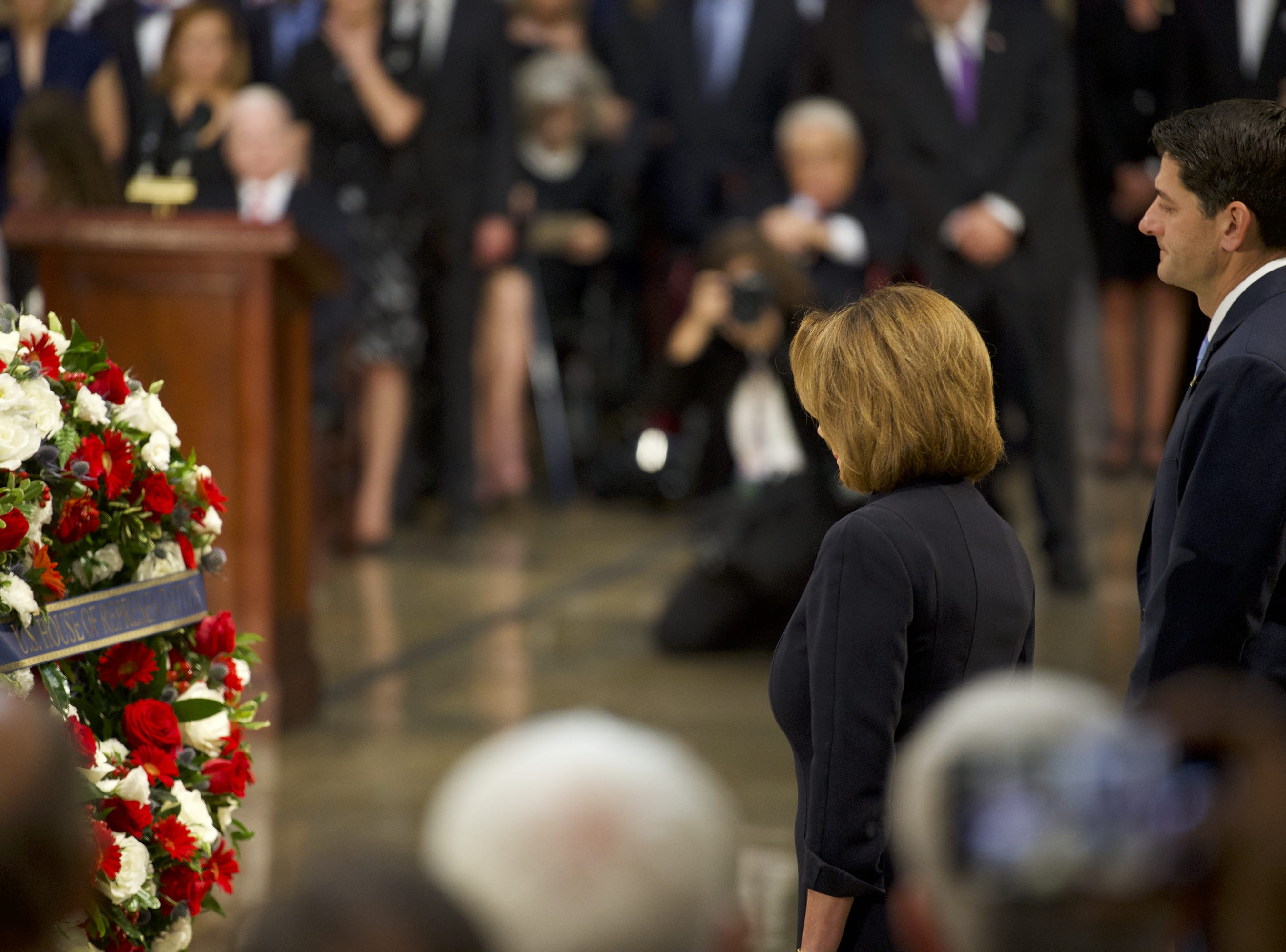 8/31/18 11:19:10 AM -- Washington, DC, U.S.A  -- House leaders Nancy Pelosi and Paul Ryan present a wreath as the body of John McCain lies in state at the U.S. Capitol in Washington on Aug. 31, 2018 in Washington. Sen. McCain died on Aug. 25. --    Photo by Jasper Colt, USA TODAY Staff