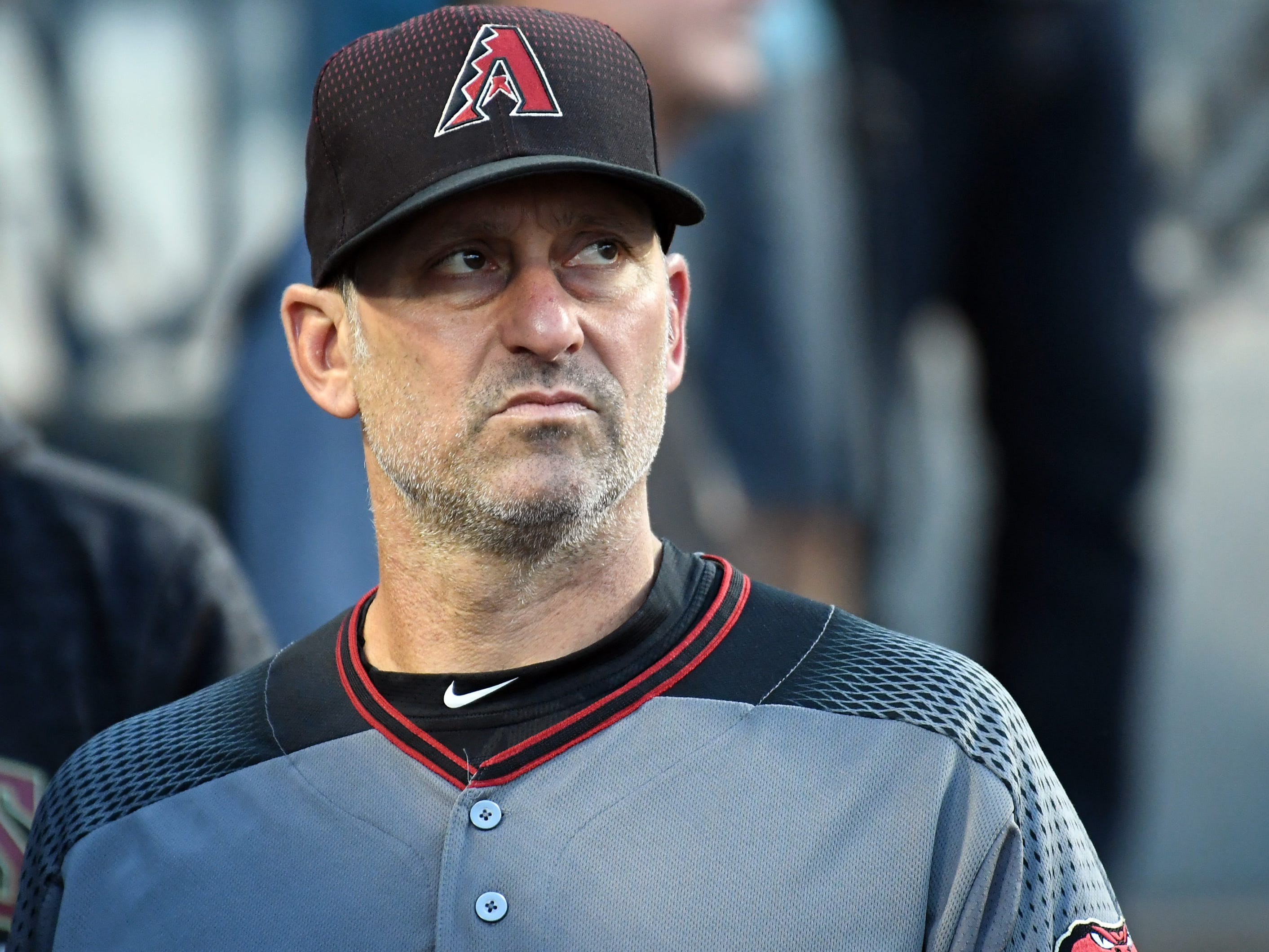Aug 30, 2018; Los Angeles, CA, USA; Arizona Diamondbacks manager Torey Lovullo (17) looks on before the game against the Los Angeles Dodgers at Dodger Stadium. Mandatory Credit: Richard Mackson-USA TODAY Sports
