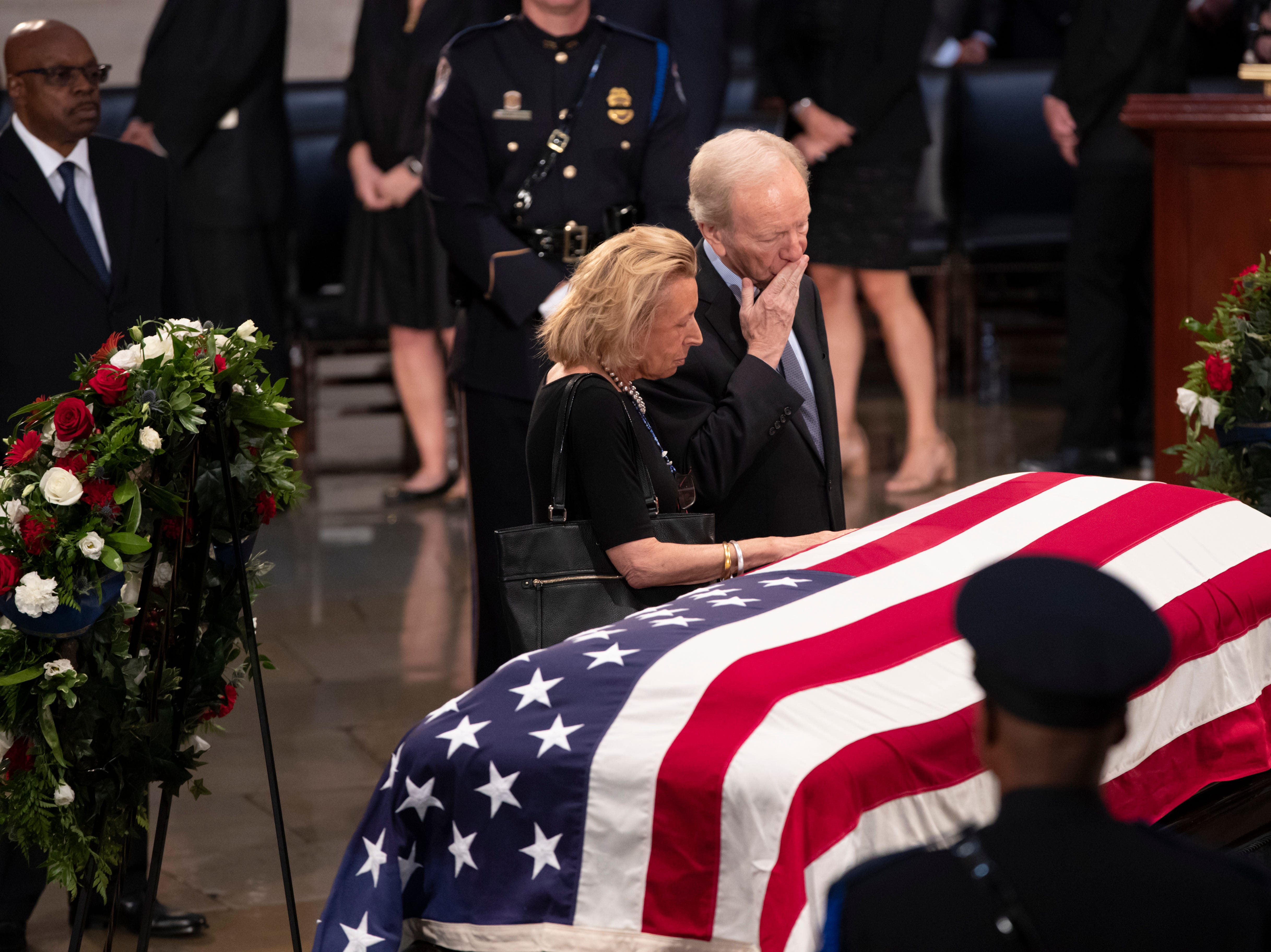 Sen. Joe Lieberman, right, and his wife Hadassah Lieberman, pay their respects at the flag-draped casket of Sen. John McCain of Arizona, who lived and worked in Congress over four decades, in the U.S. Capitol rotunda, Friday, Aug. 31, 2018, in Washington. McCain was a six-term senator, a former Republican nominee for president, and a Navy pilot who served in Vietnam, where he endured five-and-a-half years as a prisoner of war. He died Aug. 25 from brain cancer at age 81. (AP Photo/J. Scott Applewhite)
