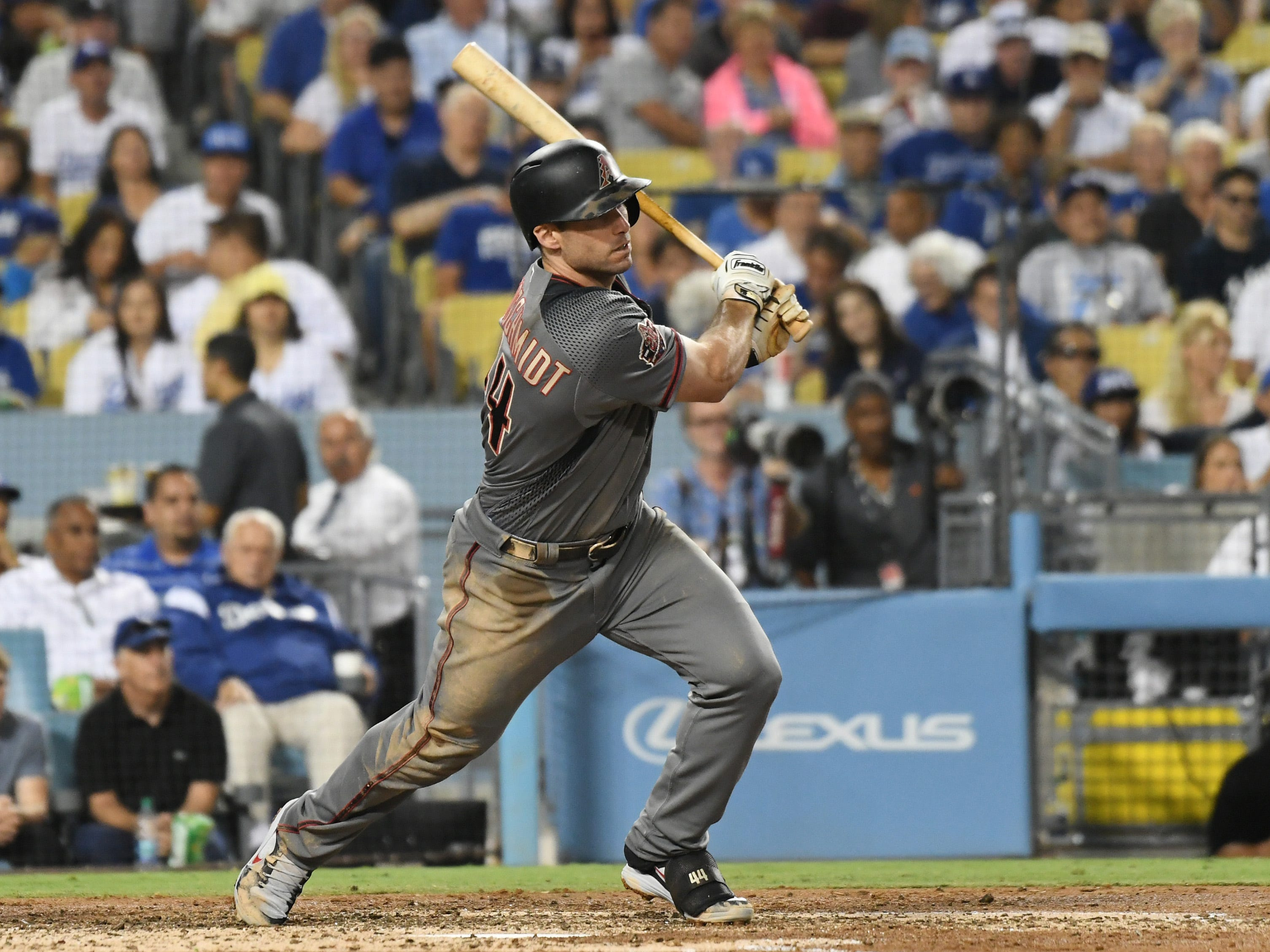 Aug 30, 2018; Los Angeles, CA, USA; Arizona Diamondbacks first baseman Paul Goldschmidt (44) hits a single against the Los Angeles Dodgers in the third inning at Dodger Stadium. Mandatory Credit: Richard Mackson-USA TODAY Sports