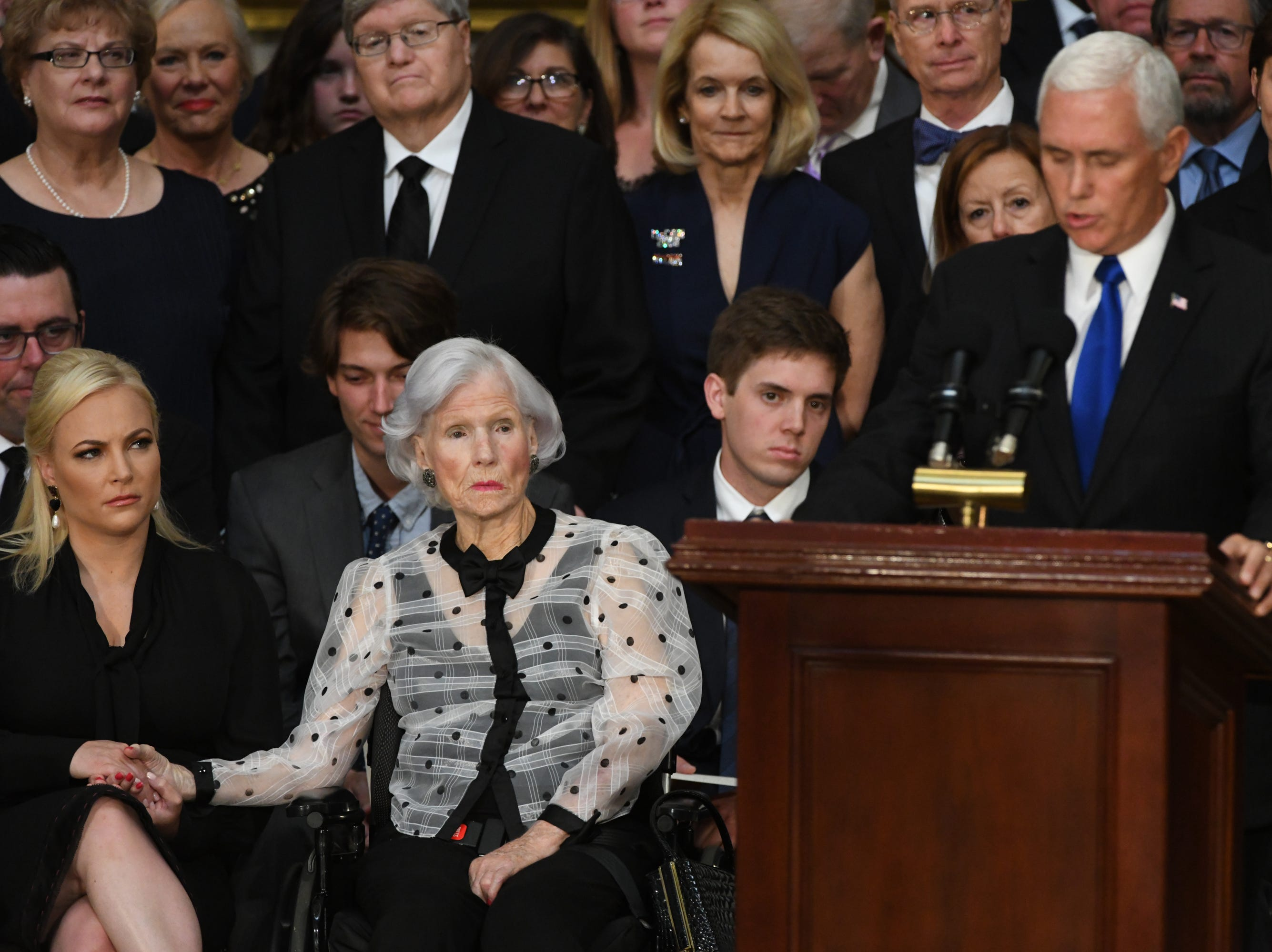 Meghan and Roberta McCain listen as Vice President Mike Pence speaks about the life of Sen. John McCain at the U.S. Capitol in Washington on Aug. 31, 2018.