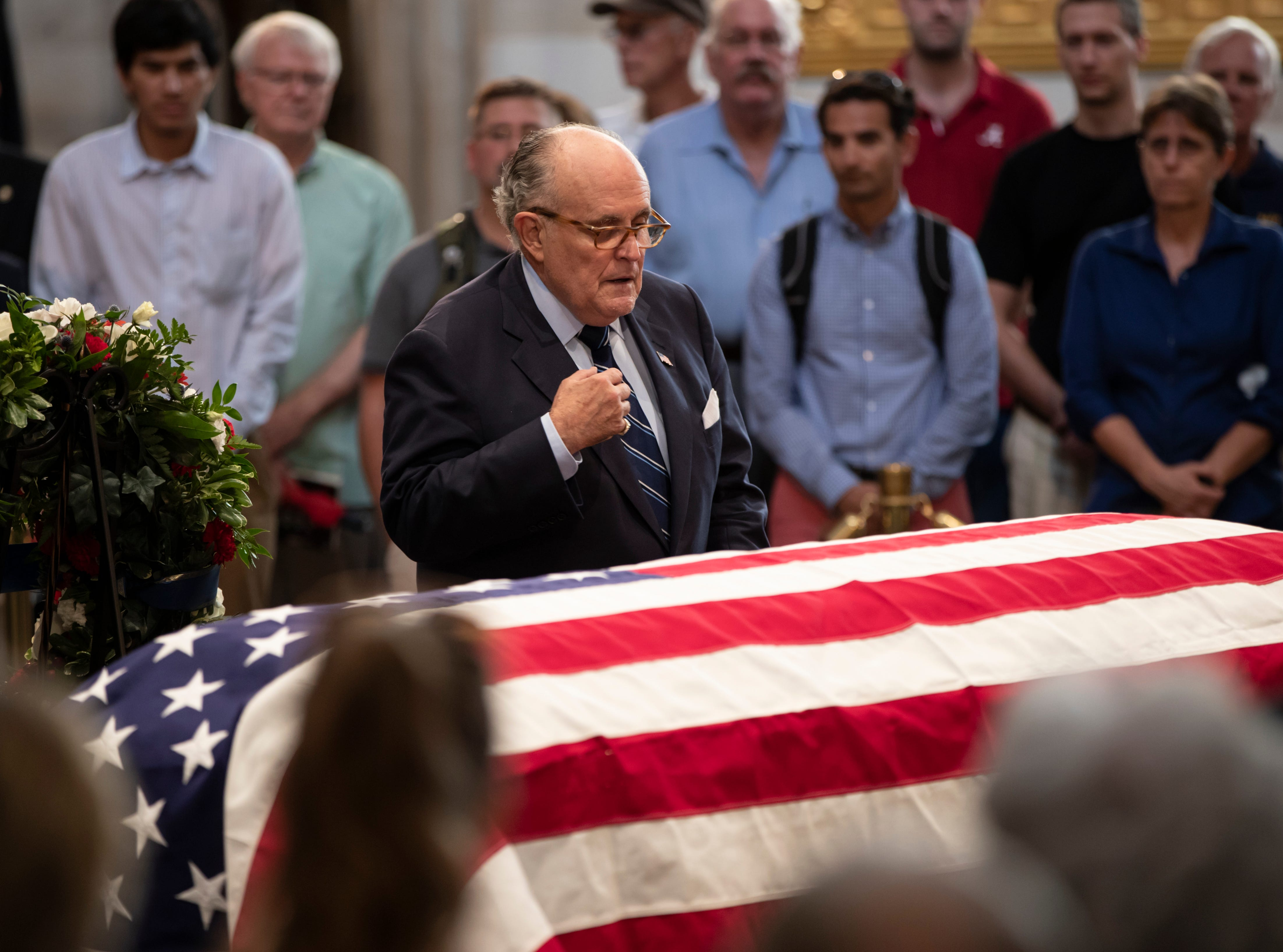 Former New York Mayor Rudy Giuliani, who currently serves as attorney to President Donald Trump, pays his respects at the flag-draped casket of Sen. John McCain of Arizona, who lived and worked in Congress over four decades, in the U.S. Capitol rotunda, Friday, Aug. 31, 2018, in Washington. (AP Photo/J. Scott Applewhite)