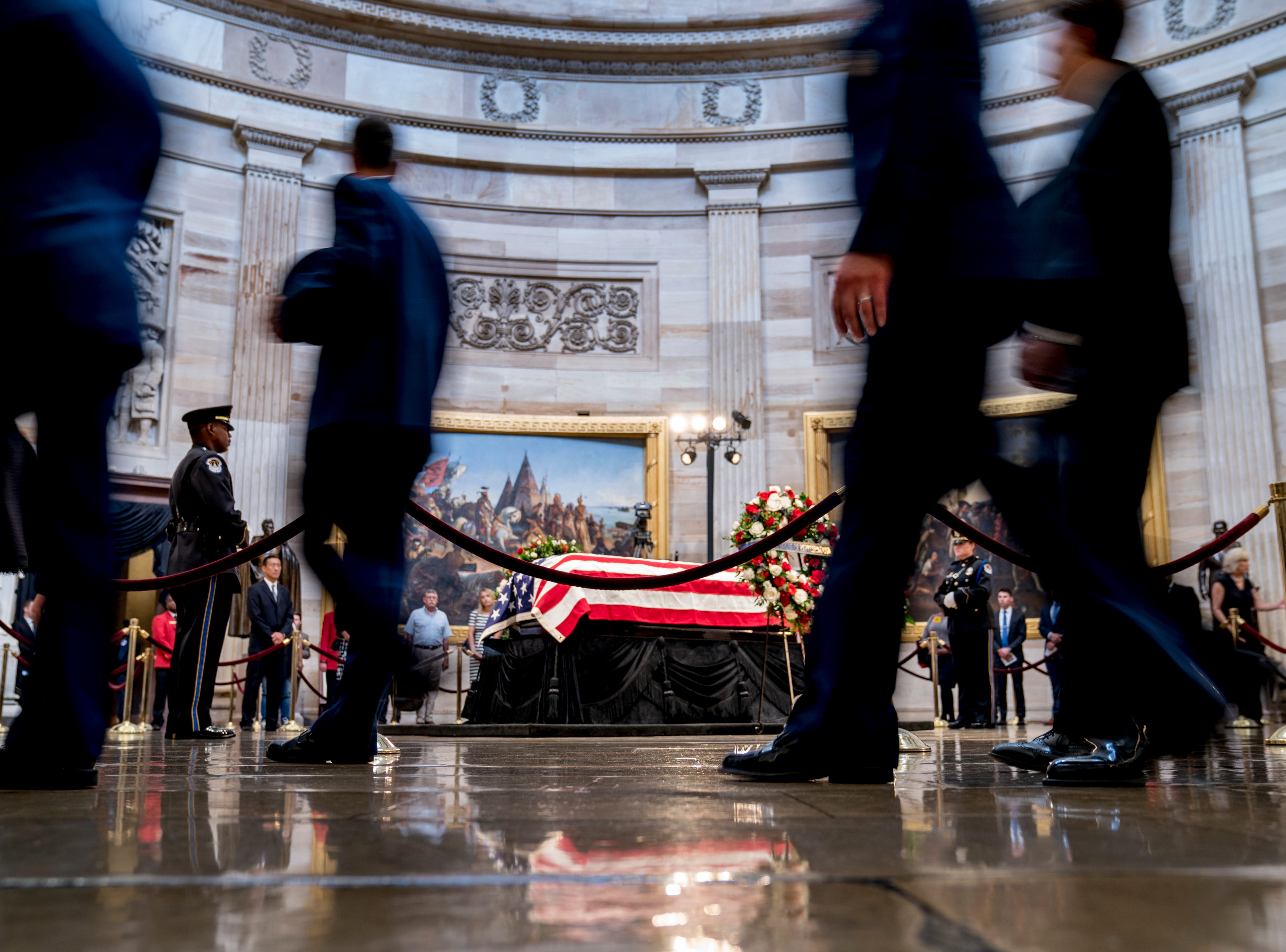 Members of the public file through the U.S. Capitol Rotunda as pay their respects to Sen. John McCain, R-Ariz., as he lies in state Friday, Aug. 31, 2018, in Washington. (AP Photo/Andrew Harnik)
