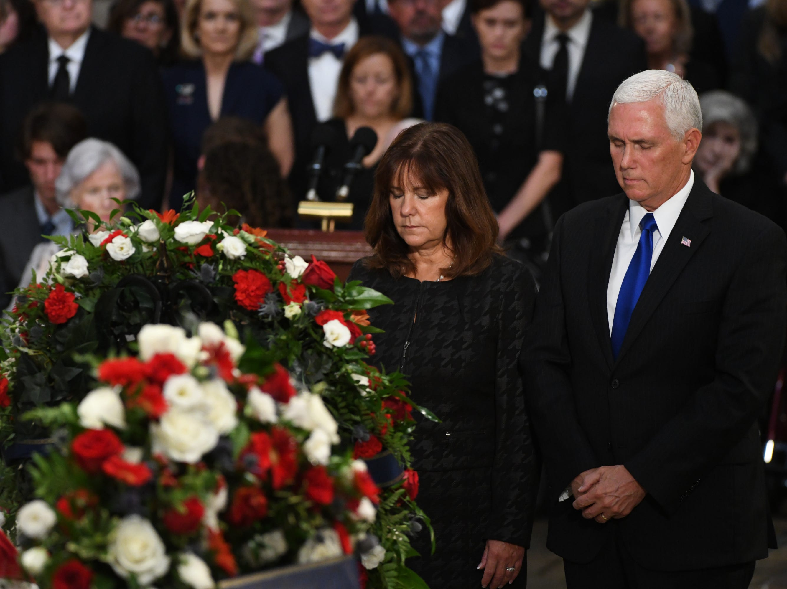 8/31/18 11:20:26 AM -- Washington, DC, U.S.A  -- Vice President Mike Pence and his wife Karen present a wreath on behalf of the Executive Branch as the body of John McCain lies in state at the U.S. Capitol in Washington on Aug. 31, 2018 in Washington. Sen. McCain died on Aug. 25. --    Photo by Jasper Colt, USA TODAY Staff