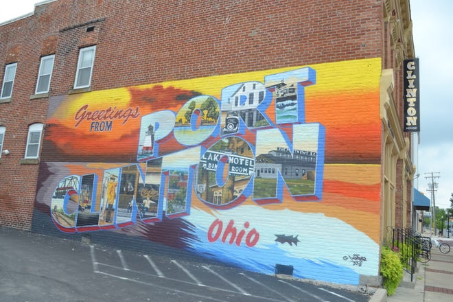 This mural depicting images of Port Clinton's history was painted this summer on the side of the Clinton House by  Toledo artist Ken Dushane using spray paint.