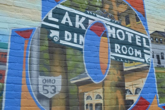 Ken Dushane relied on the memories of older local residents when he chose to paint the Lake Hotel sign blue.