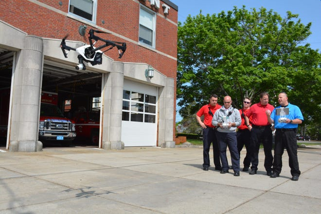Instructors from DARTdrone operate a drone.