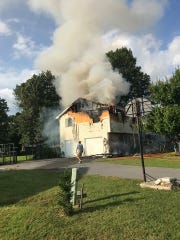 Smoke billows from a home at 10068 Blue Jay Circle, Letterkenny Township, shortly after a fire broke out at about 5:19 p.m. Thursday, Aug. 30, 2018. No one was injured. One of three pets, a cat, died in the blaze.