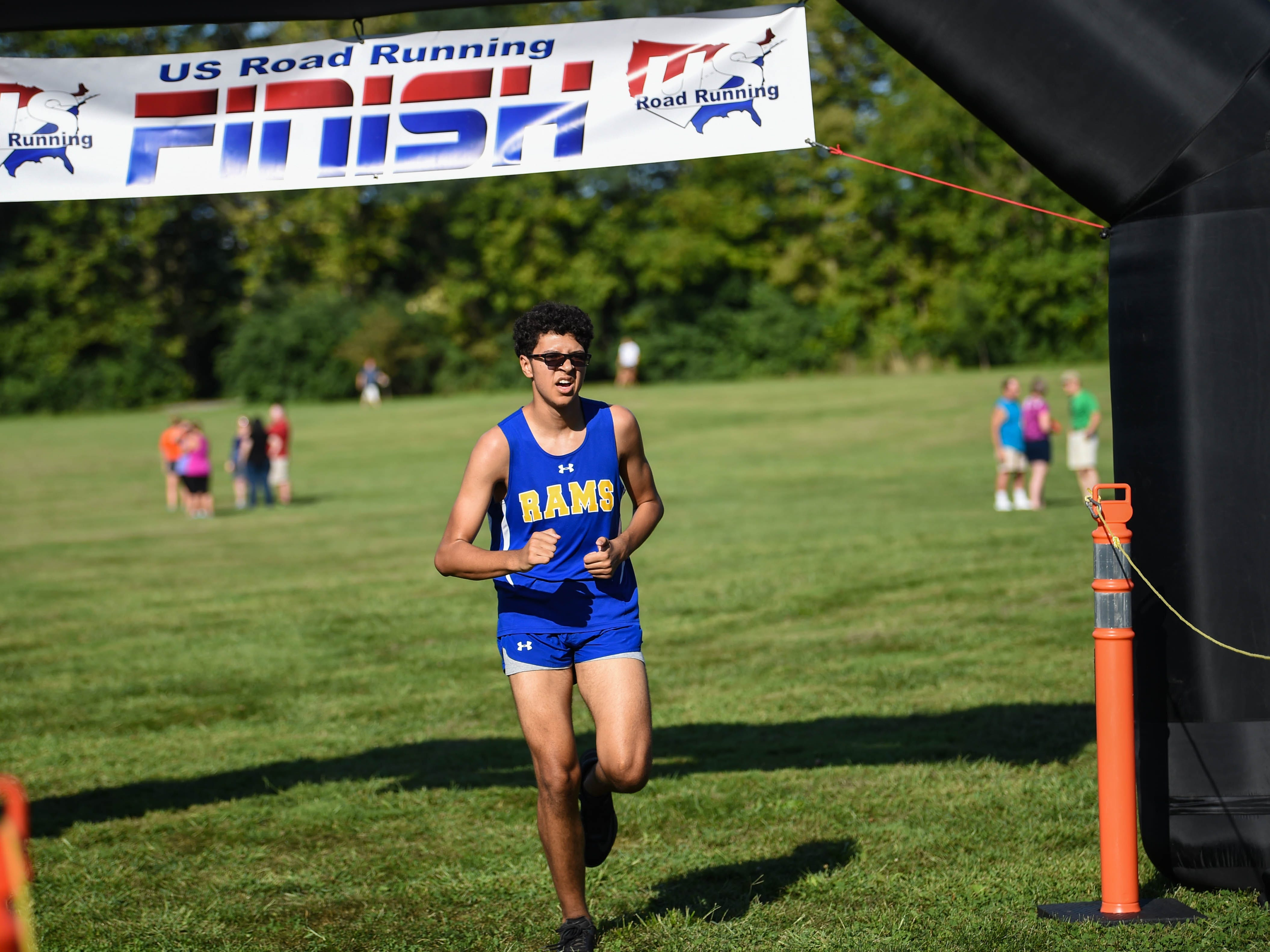 A Kennard-Dale runner jogs through the finish during the Cross Country scrimmage at John Rudy County Park on August 30, 2018.