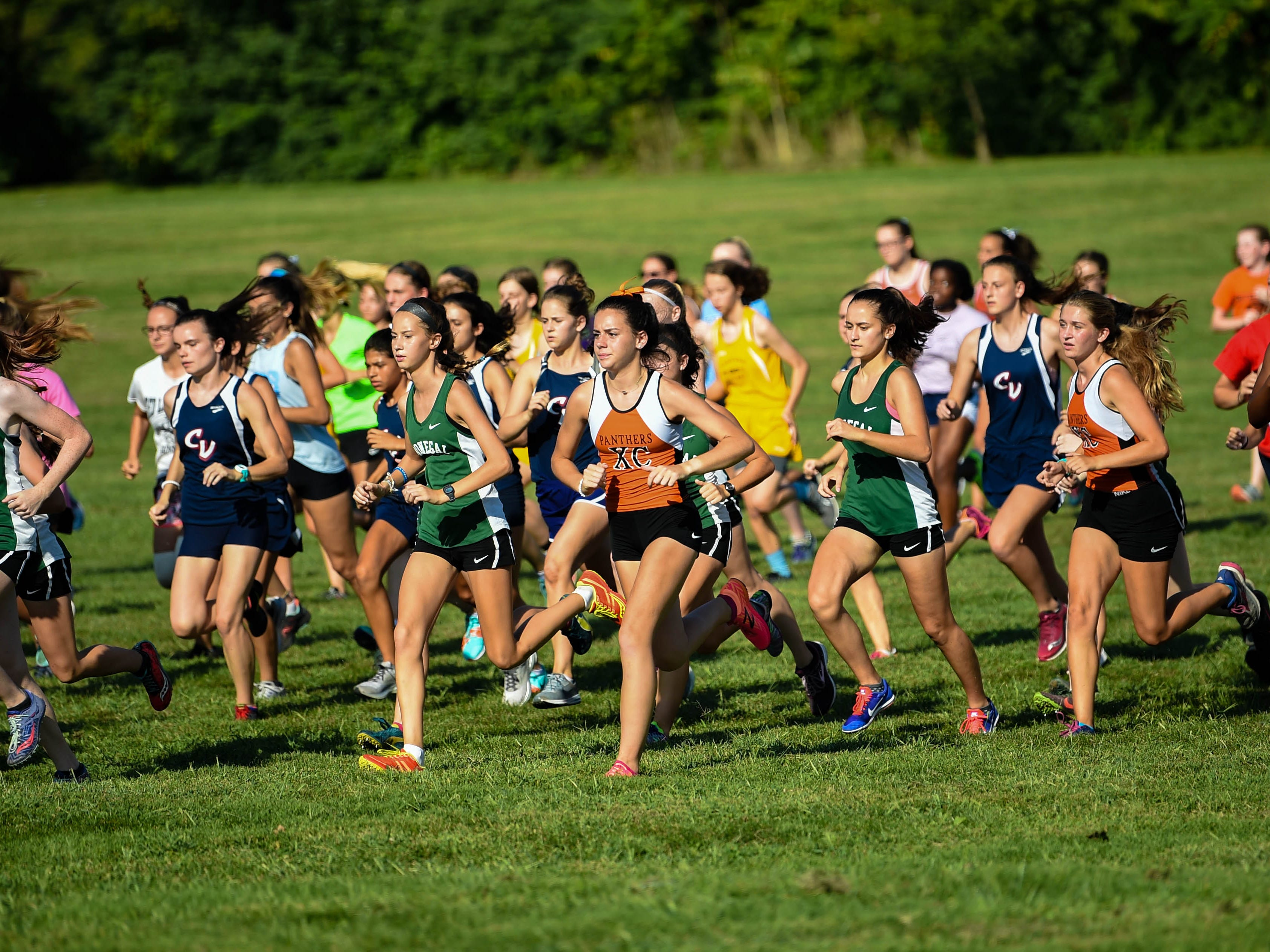 The girls fight for position at the start of the Cross Country scrimmage at John Rudy County Park on August 30, 2018.