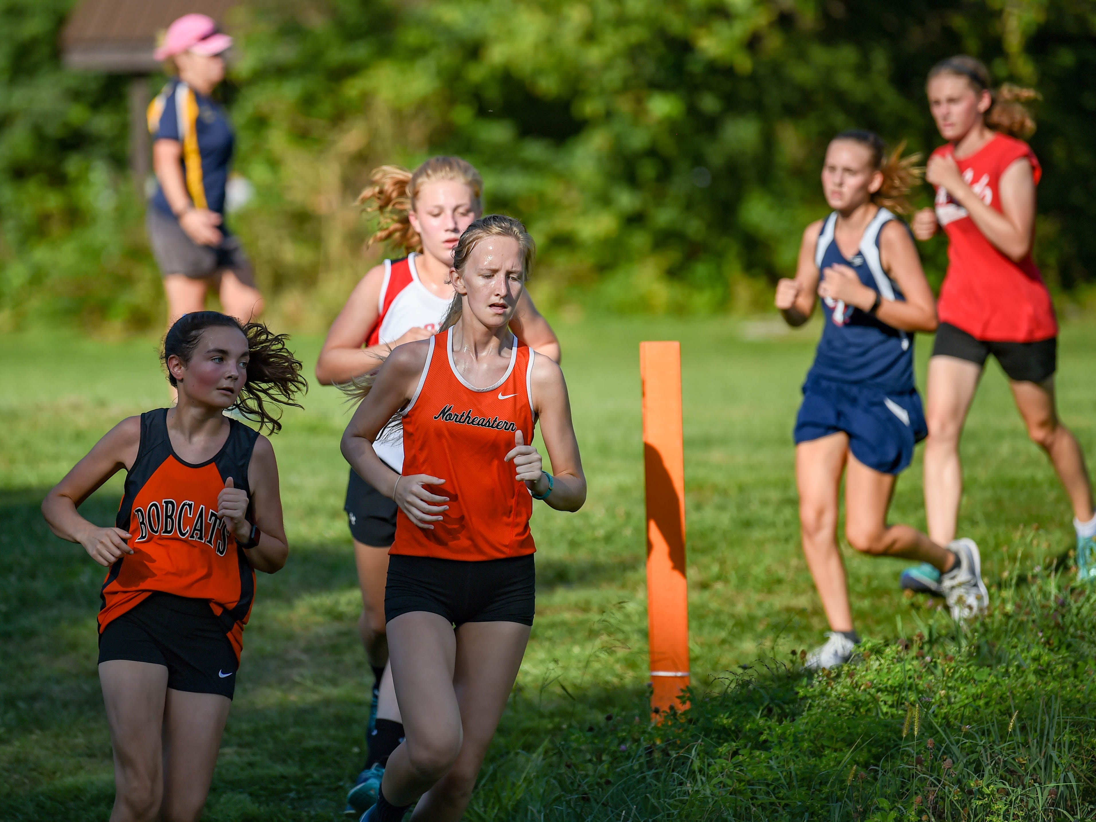 Northeastern teammates run side by side during the Cross Country scrimmage at John Rudy County Park on August 30, 2018.