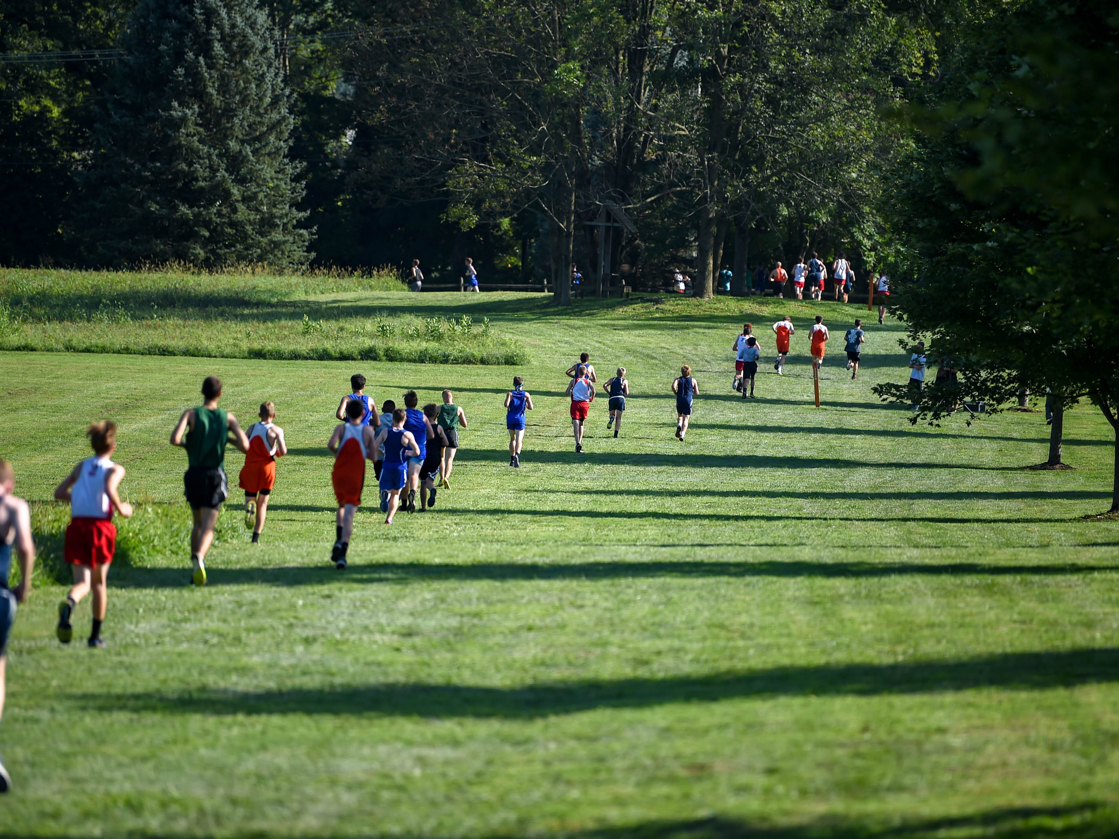 The boys catch their stride during the Cross Country scrimmage at John Rudy County Park on August 30, 2018.